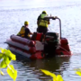 Crews working to get car out of Arkansas River