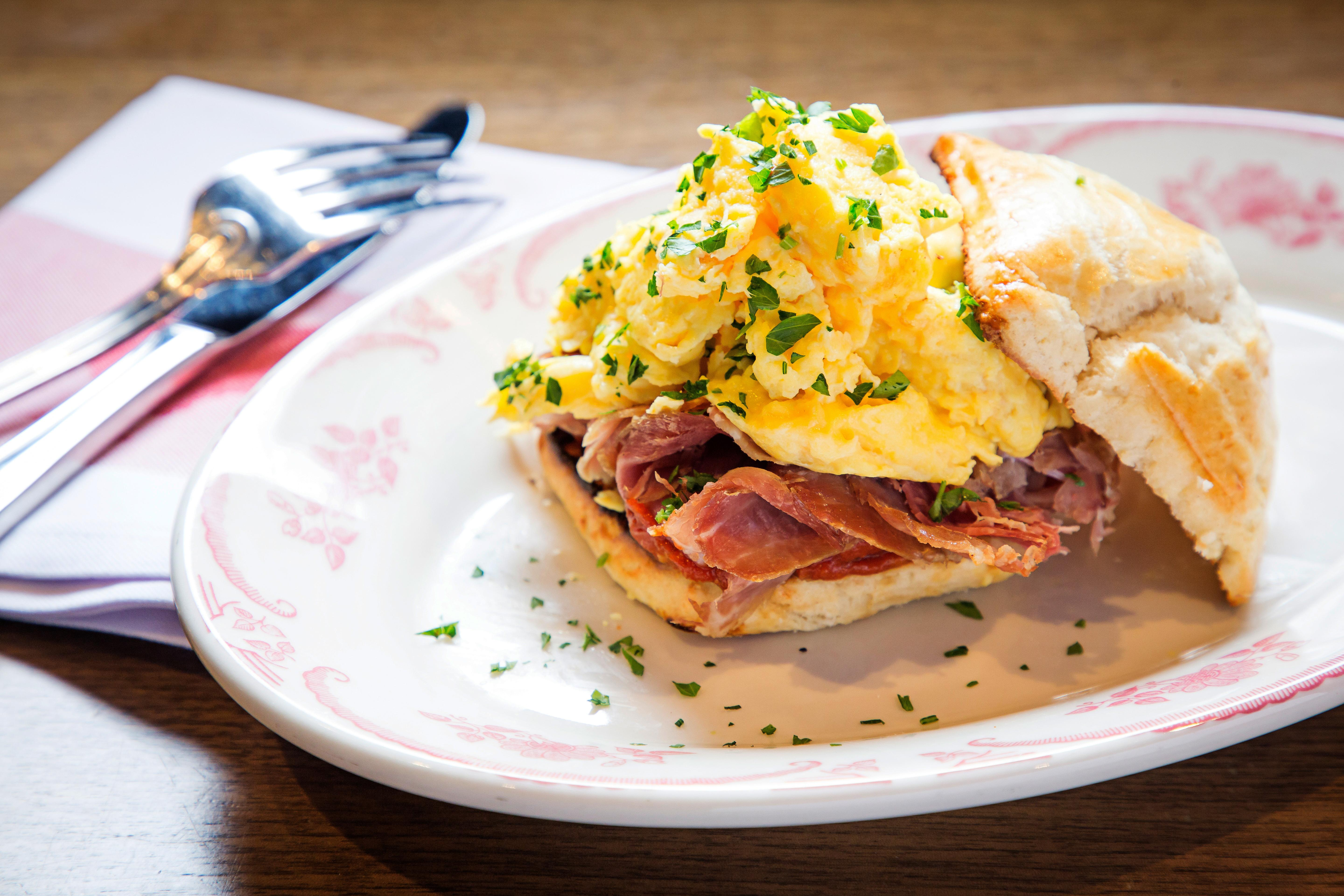 Thanks to Chef Marcus Samuelsson, you don't even have to get out of bed to enjoy a breakfast sandwich at the MGM National Harbor. The Beaten Biscuit Sandwich (cheesy scrambled egg, country ham, and tomato jam) is available through in-room dining and at the restaurant ($12). (Image: Courtesy Marcus)