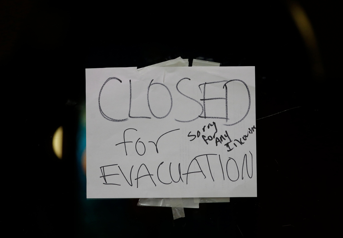 A closed sign is displayed on the door of Papaciito's restaurant due to an evacuation order Sunday, Feb. 12, 2017, in Marysville, Calif. Thousands of Northern California residents remain under evacuation orders after authorities warned an emergency spillway in the country's tallest Oroville Dam was in danger of failing Sunday and unleashing uncontrolled flood waters on towns below. (AP Photo/Rich Pedroncelli)