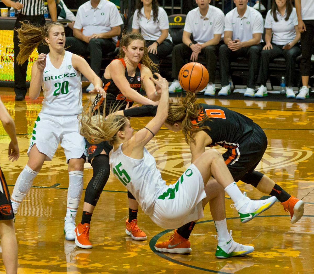 Oregon Ducks Anneli Maley (#15) falls to the floor after colliding with Oregon State Beavers Mikayla Pivec (#0). Maley drew both a personal foul and a technical foul on the play. The Oregon Ducks defeated the Oregon State Beavers 75-63 on Sunday afternoon in front of a crowd of 7,249 at Matthew Knight Arena. The Ducks and Beavers split the two game Civil War with the Beavers defeating the Ducks on Friday night in Corvallis. The Ducks had four players in double digits: Satou Sabally with 21 points, Maite Cazorla with 16, Sabrina Ionescu with 15, and Mallory McGwire with 14. The Ducks shot 48.4% from the floor compared to the Beavers 37.3%. The Ducks are now 7-1 in conference play. Photo by Dan Morrison, Oregon News Lab