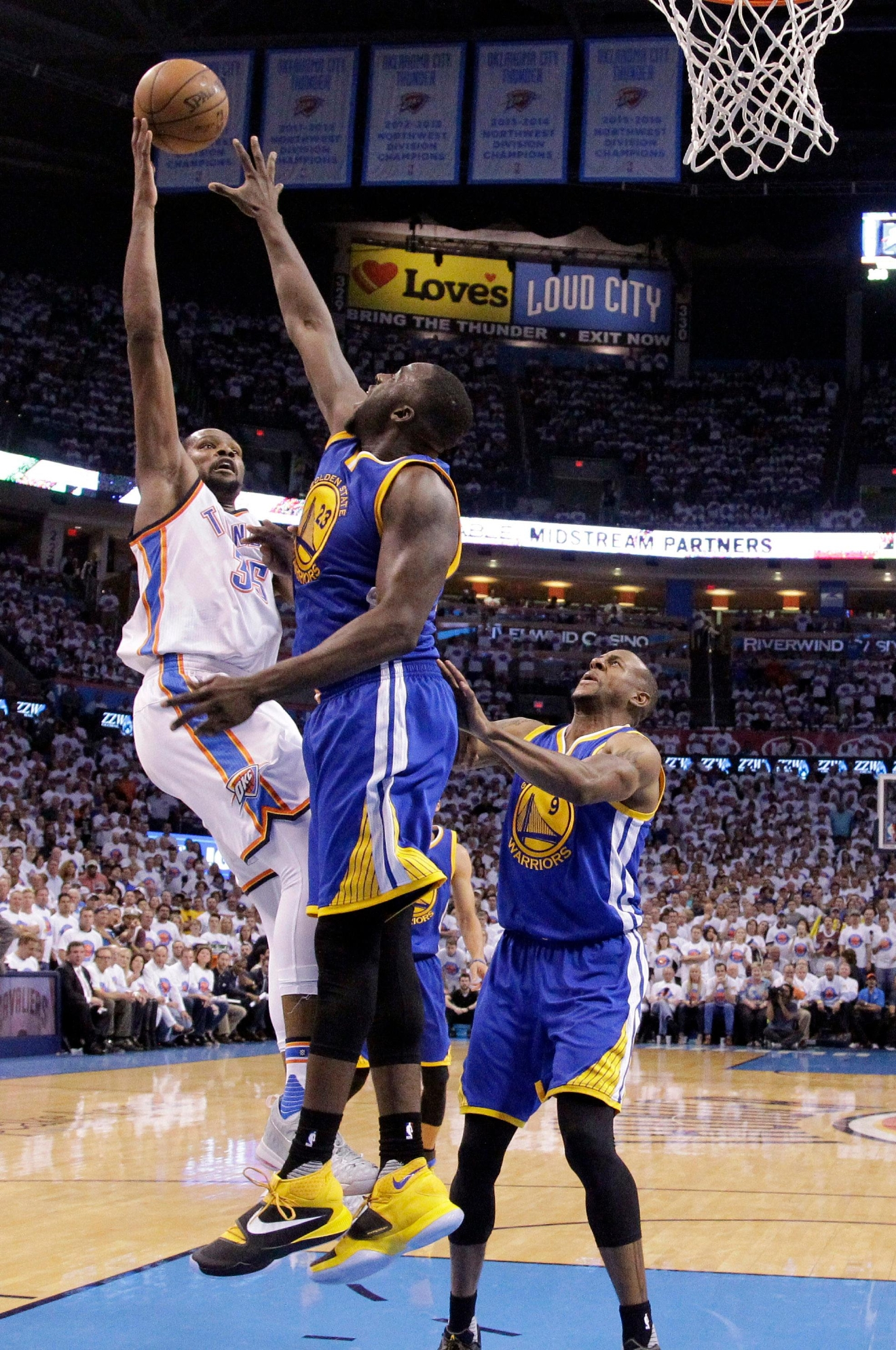 Oklahoma City Thunder forward Kevin Durant (35) shoots as Golden State Warriors forward Draymond Green (23) and forward Andre Iguodala (9) during the second half in Game 4 of the NBA basketball Western Conference finals in Oklahoma City, Tuesday, May 24, 2016. The Thunder won 118-94. (AP Photo/Sue Ogrocki)