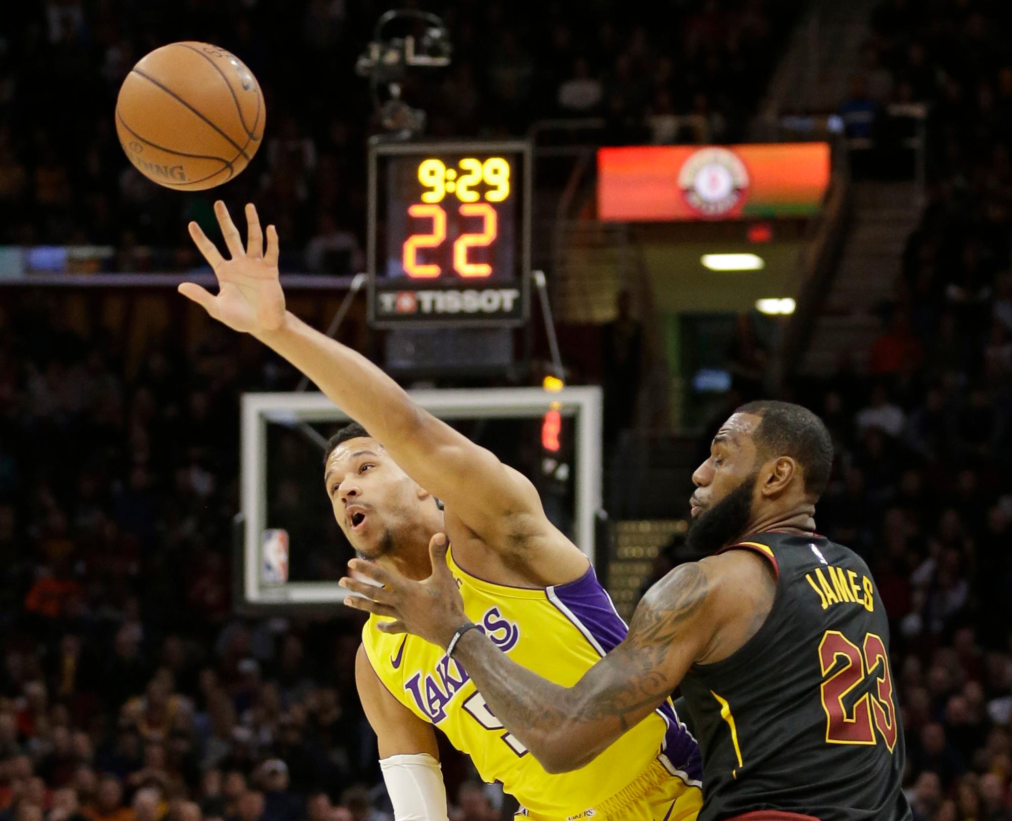 Los Angeles Lakers' Josh Hart (5) grabs a pass ahead of Cleveland Cavaliers' LeBron James (23) in the first half of an NBA basketball game, Thursday, Dec. 14, 2017, in Cleveland. (AP Photo/Tony Dejak)