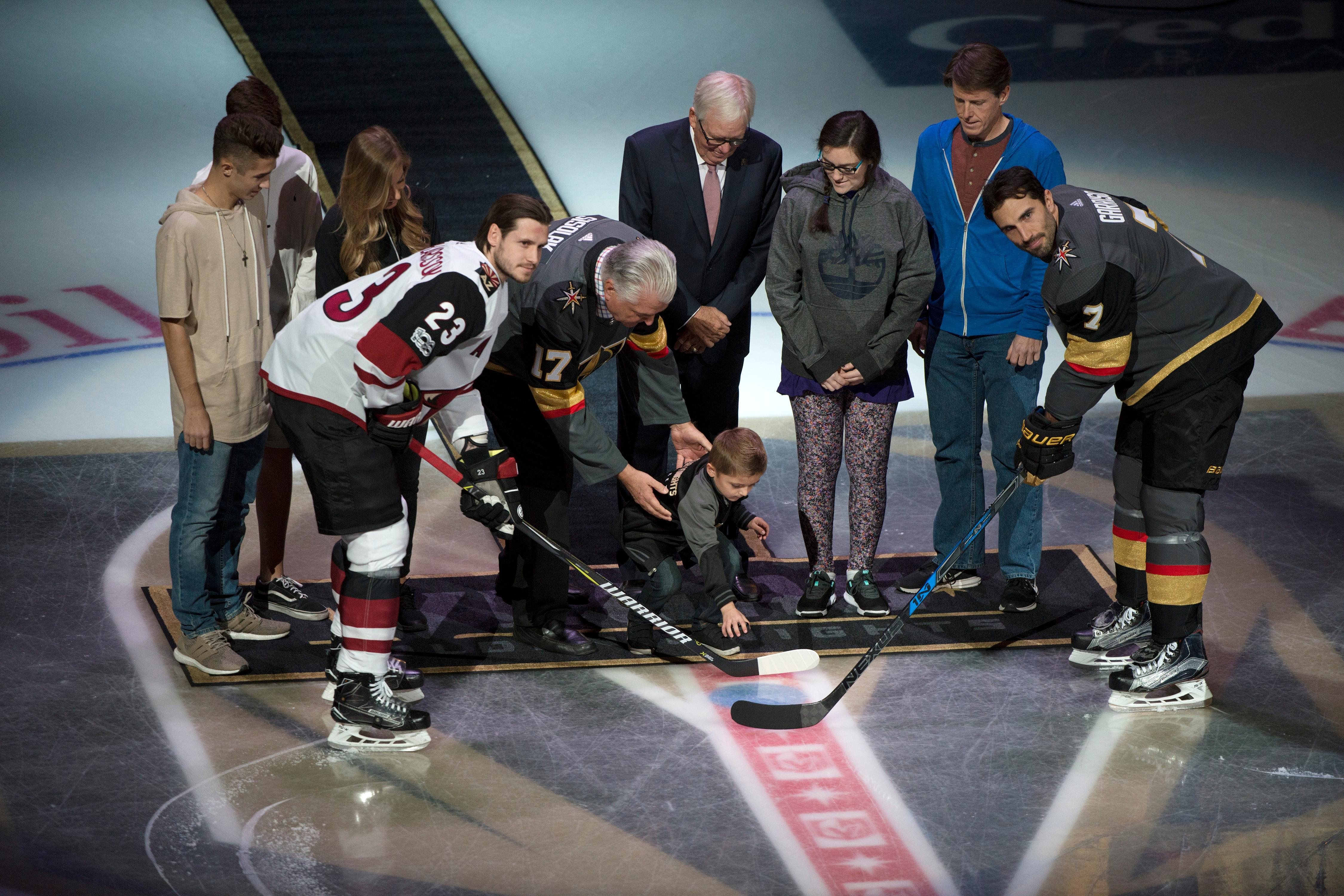 Survivors of the October 1st tragedy participate in a puck drop before the Vegas Golden Knights home opener against the Arizona Coyotes Tuesday, Oct. 10, 2017, at the T-Mobile Arena. The Knights won 5-2 to extend their winning streak to 3-0. CREDIT: Sam Morris/Las Vegas News Bureau