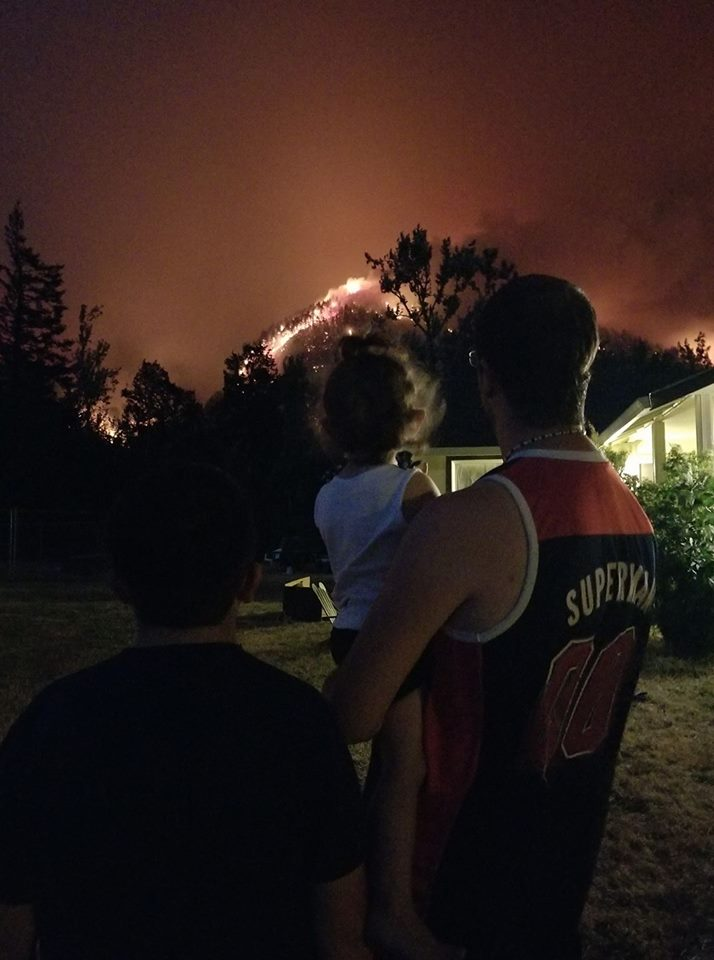 A family watches the fire from their yard in North Bonneville, Washington. (Photo: Sandra Lee Mckenzie)