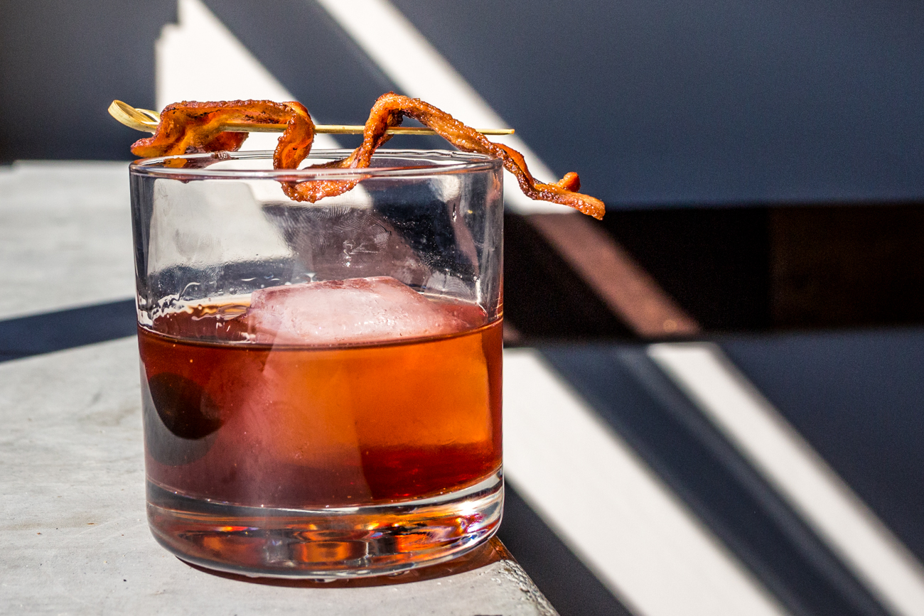 Bacon Old Fashioned: bacon infused Redemption Rye bourbon, orange bitters, Angastora bitters, and garnished with cherry and bacon / Image: Catherine Viox // Published: 11.10.19