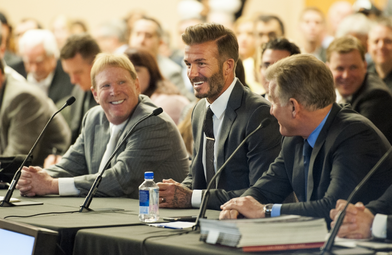Soccer star David Beckham, center, flanked by Oakland Raiders owner Mark Davis, left, and Rob Goldstein, president and COO of Las Vegas Sands, addresses a meeting of the Southern Nevada Tourism Infrastructure Committee at the Stan Fulton Building, UNLV on Thursday, April 28, 2016. Davis and Beckham talked about the initiative to build a domed stadium in Las Vegas which would attract the NFL, major league soccer and other attractions. (Mark Damon/Las Vegas News Bureau)