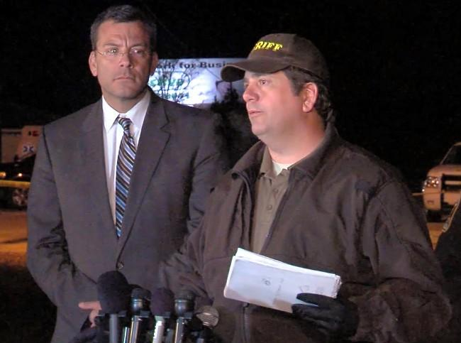 Dale County Sheriff Wally Olson updates the media on the hostage standoff Thursday night.