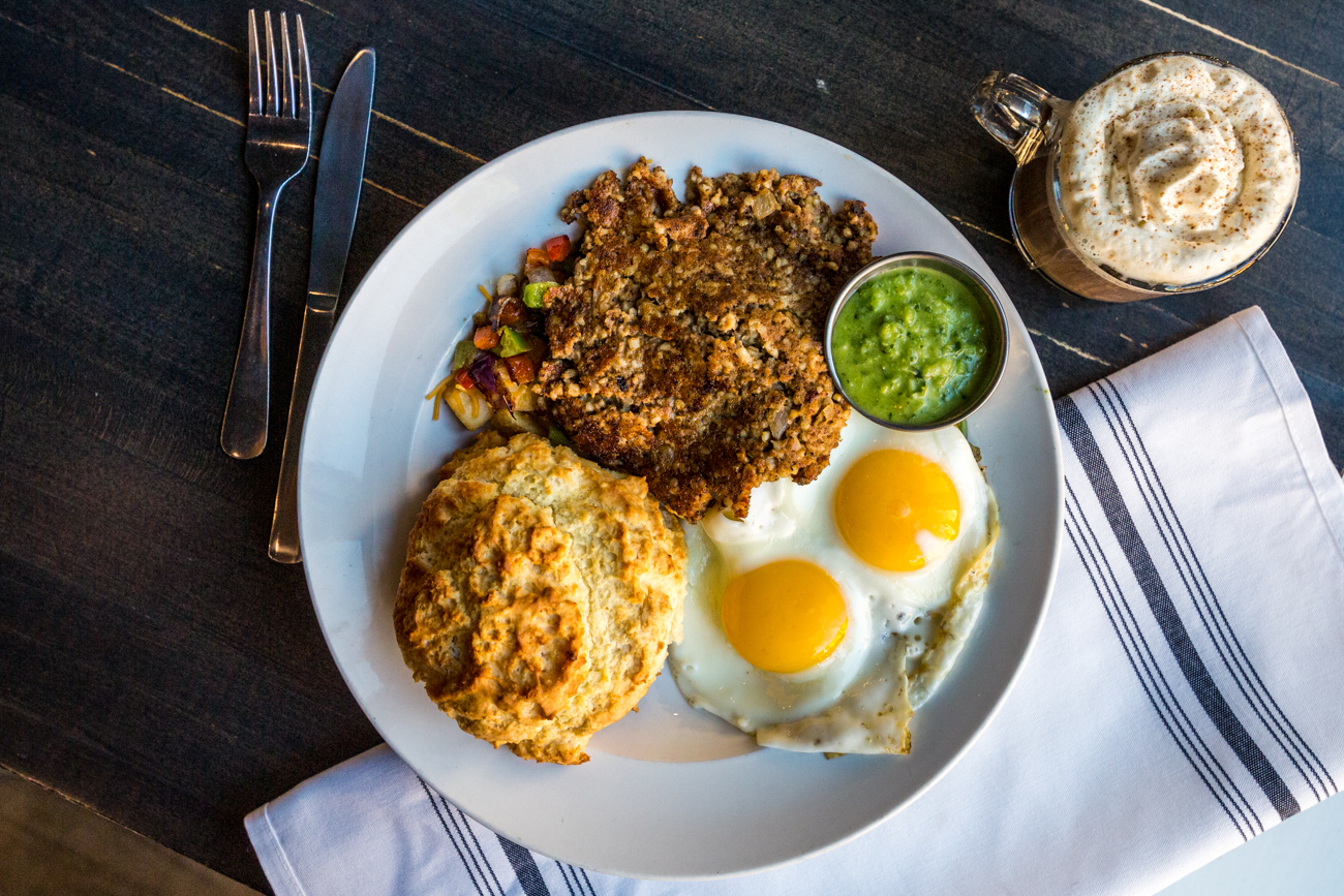 B&A Street Kitchen's Good Morning OTR: hash with two eggs any style, goetta (regular or vegan), grilled veggies, cheddar cheese, and green onion with a biscuit and the seasonal fall latte on the side / Image: Catherine Viox{ }// Published: 11.12.19