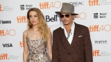 Amber Heard asks court for restraining order against Johnny Depp, claiming abuse