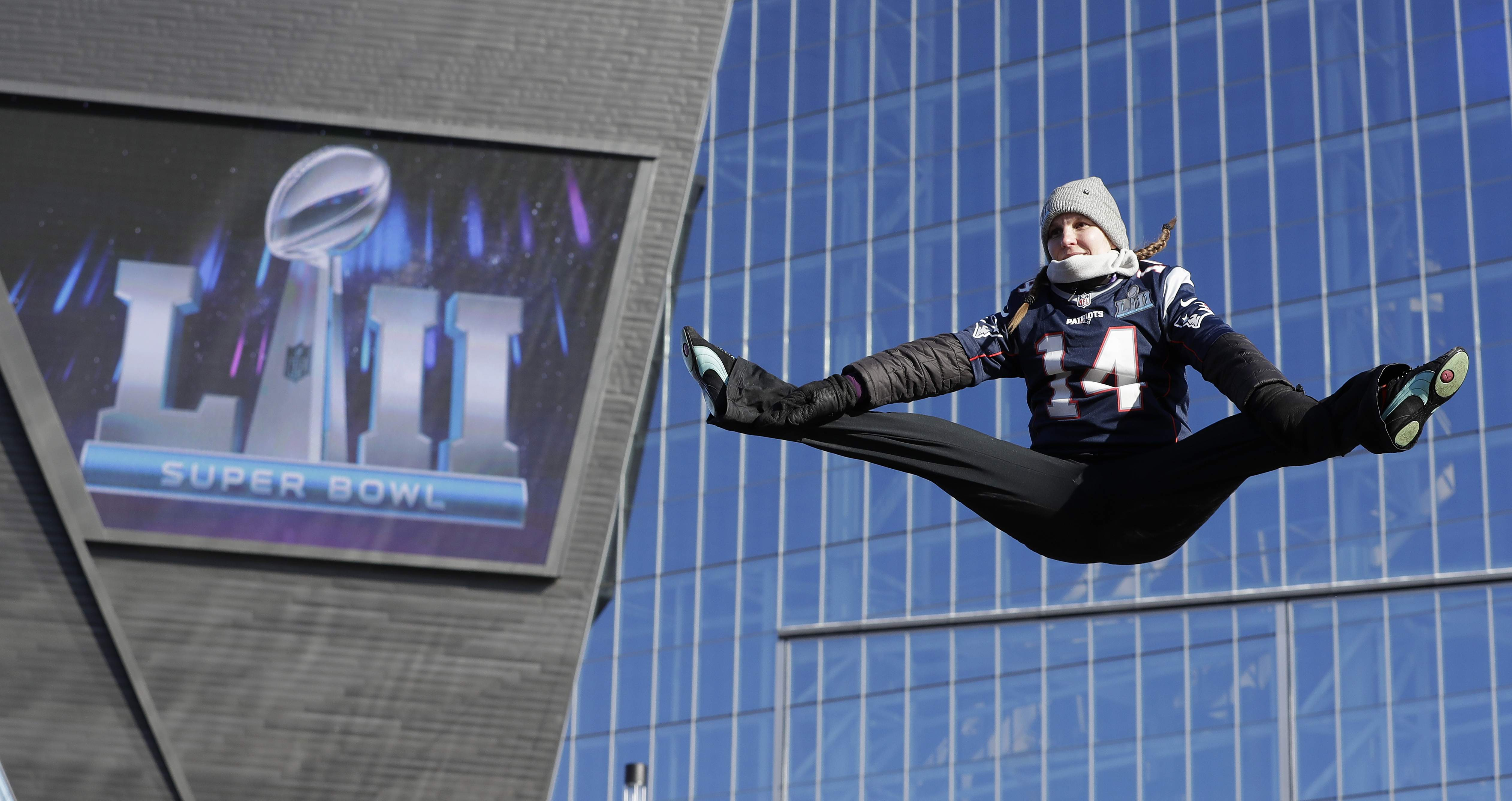 A fan jumps on a trampoline outside U.S. Bank Stadium before the NFL Super Bowl 52 football game between the Philadelphia Eagles and the New England Patriots Sunday, Feb. 4, 2018, in Minneapolis. (AP Photo/Mark Humphrey)
