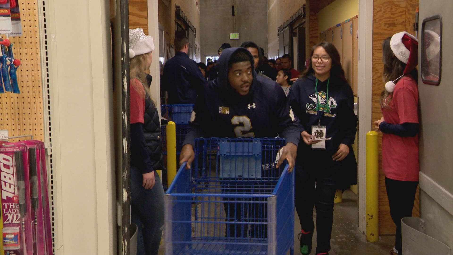 Notre Dame football team enters Meijer shopping center during 6th annual Shop with a Player event // WSBT 22 Photo<p></p>
