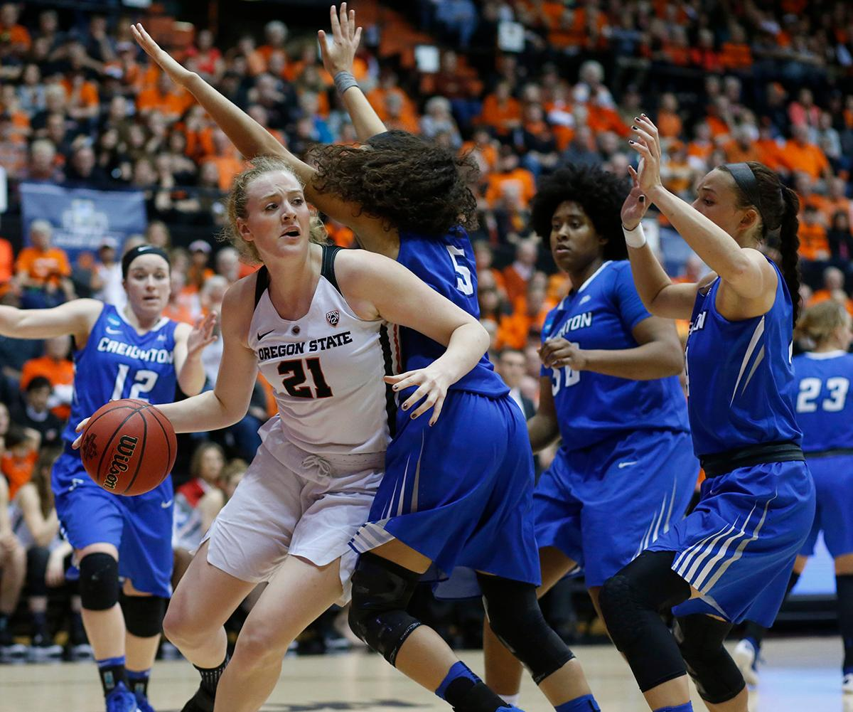 Oregon State's Marie Gulich (21) tries to get around Creighton's Jaylyn Agnew (5) during the second half of a second-round game in the NCAA women's college basketball tournament Sunday, March 19, 2017, in Corvallis, Ore. Oregon State won 64-52. (AP Photo/Timothy J. Gonzalez)