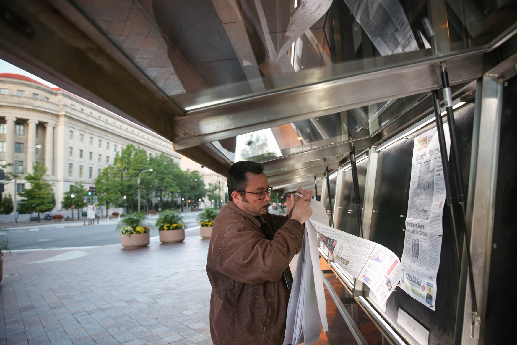 Machado and his team put the newspapers outside at around 8:00 a.m.{ }(Amanda Andrade-Rhoades/DC Refined)