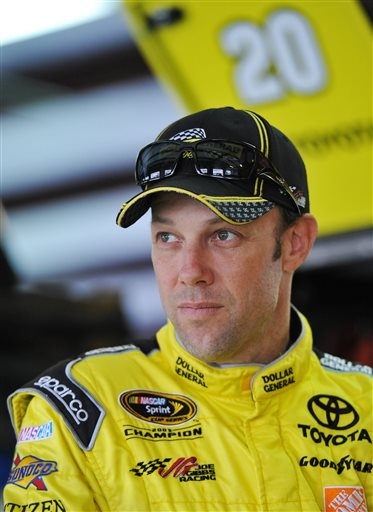 Driver Matt Kenseth stands in the garage area before practice for Sunday's Aaron's 499 NASCAR auto race at Talladega Superspeedway on Friday, May 2, 2014, in Talladega, Ala.