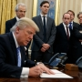 President Trump signs executive order, freezes federal hiring and pay raises