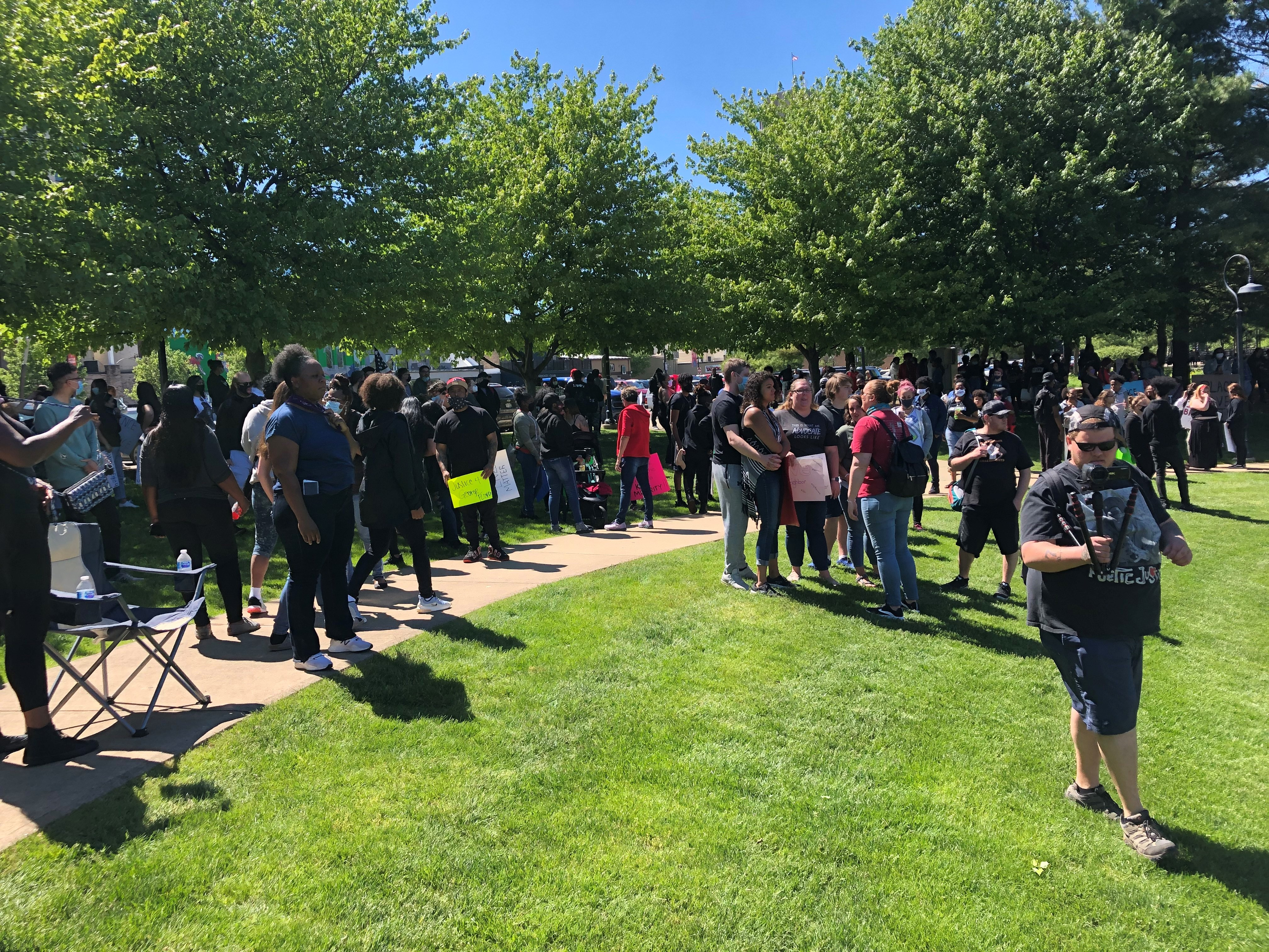 On Sunday, May 31, 2020 people walked throughout the streets of Battle Creek with signs protesting the death of George Floyd. (WWMT/Sam Knef)