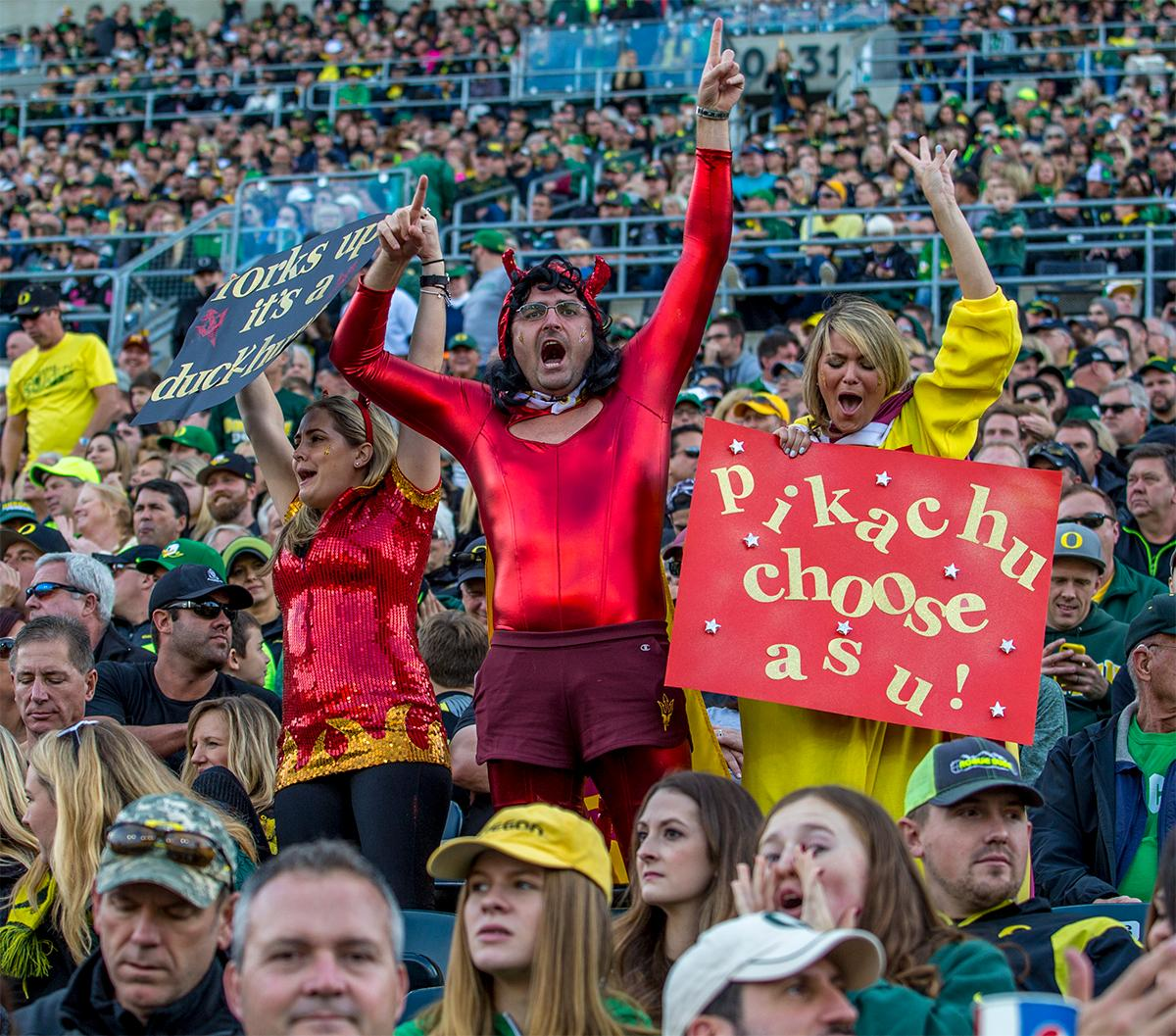 Fans decked out and ready for Halloween yell encouragement to the Ducks team. Oregon lead at the end of the 1st half 30-14. Photos by August Frank, Oregon News Lab