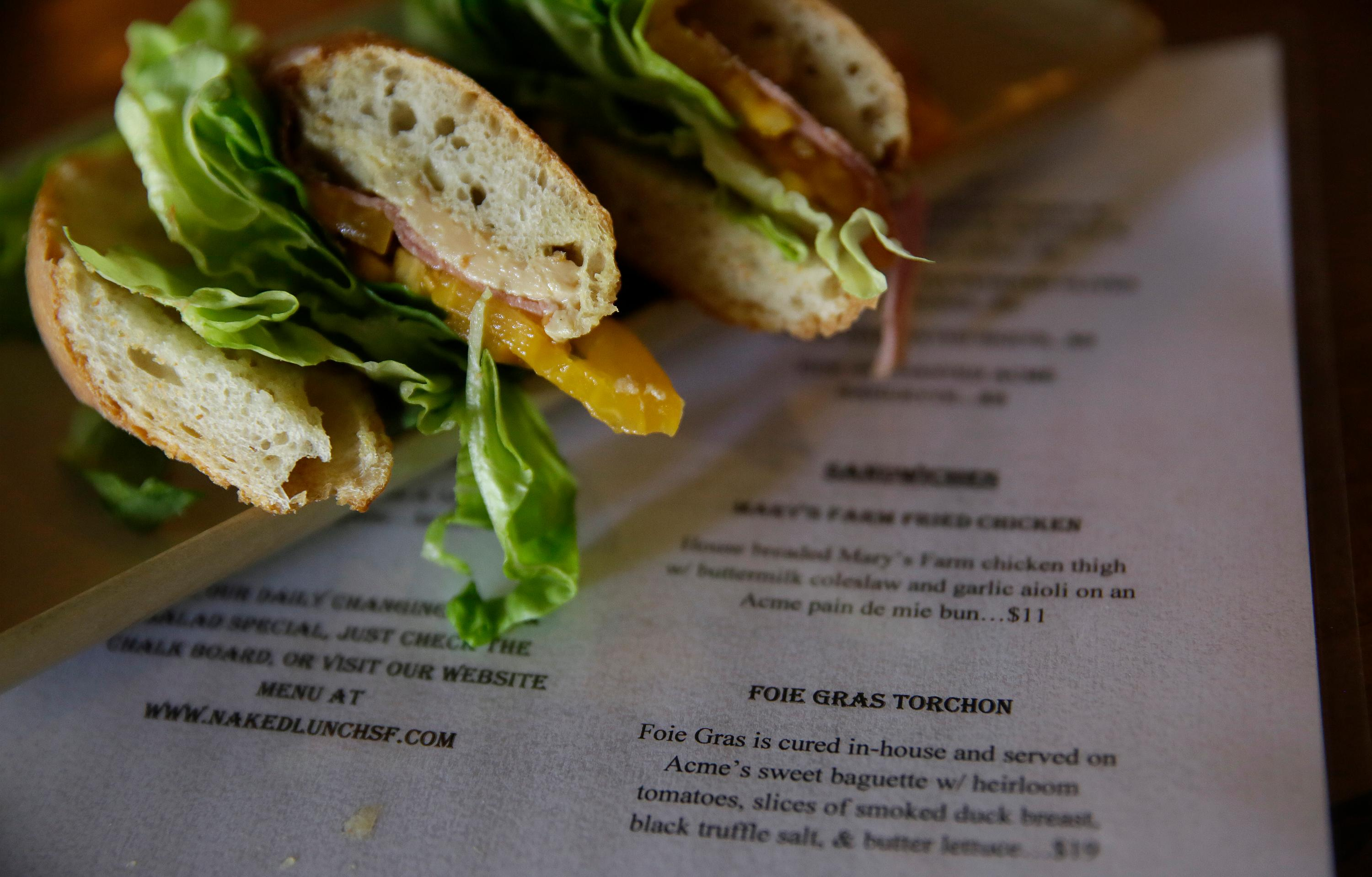 A Foie Gras Torchon sandwich is seen at the Naked Lunch restaurant Friday, Sept. 15, 2017, in San Francisco.  (AP Photo/Eric Risberg)