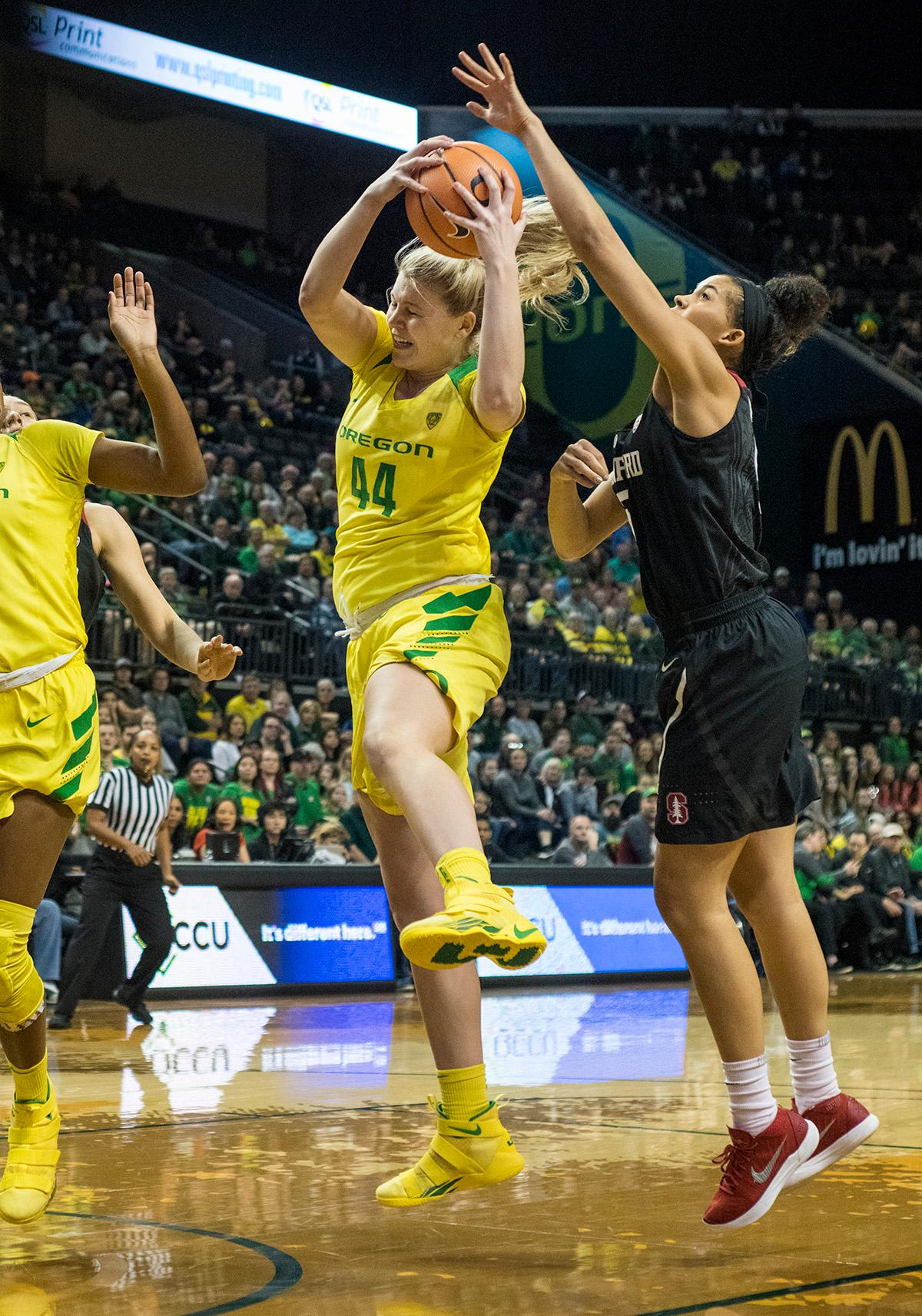 Oregon Ducks Mallory McGwire (#44) attempts to make her way to the basket past Stanford Cardinal defense. The Stanford Cardinal defeated the Oregon Ducks 78-65 on Sunday afternoon at Matthew Knight Arena. Stanford is now 10-2 in conference play and with this loss the Ducks drop to 10-2. Leading the Stanford Cardinal was Brittany McPhee with 33 points, Alanna Smith with 14 points, and Kiana Williams with 14 points. For the Ducks Sabrina Ionescu led with 22 points, Ruthy Hebard added 16 points, and Satou Sabally put in 14 points. Photo by Rhianna Gelhart, Oregon News Lab