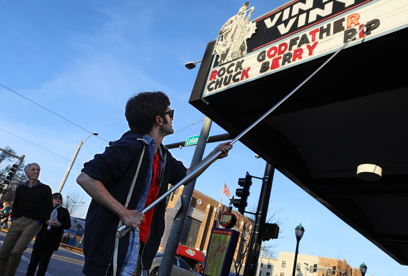 "Teddy Kogos, of Vintage Vinyl, changes the marquee at the famed record store on the Delmar Loop in University City, Mo., to mark the death of music legend Chuck Berry on Saturday, March 18, 2017.  Berry, rock 'n' roll's founding guitar hero and storyteller who defined the music's joy and rebellion in such classics as ""Johnny B. Goode,"" ''Sweet Little Sixteen"" and ""Roll Over Beethoven,"" died Saturday at his home west of St. Louis. He was 90. (David Carson/St. Louis Post-Dispatch via AP)"