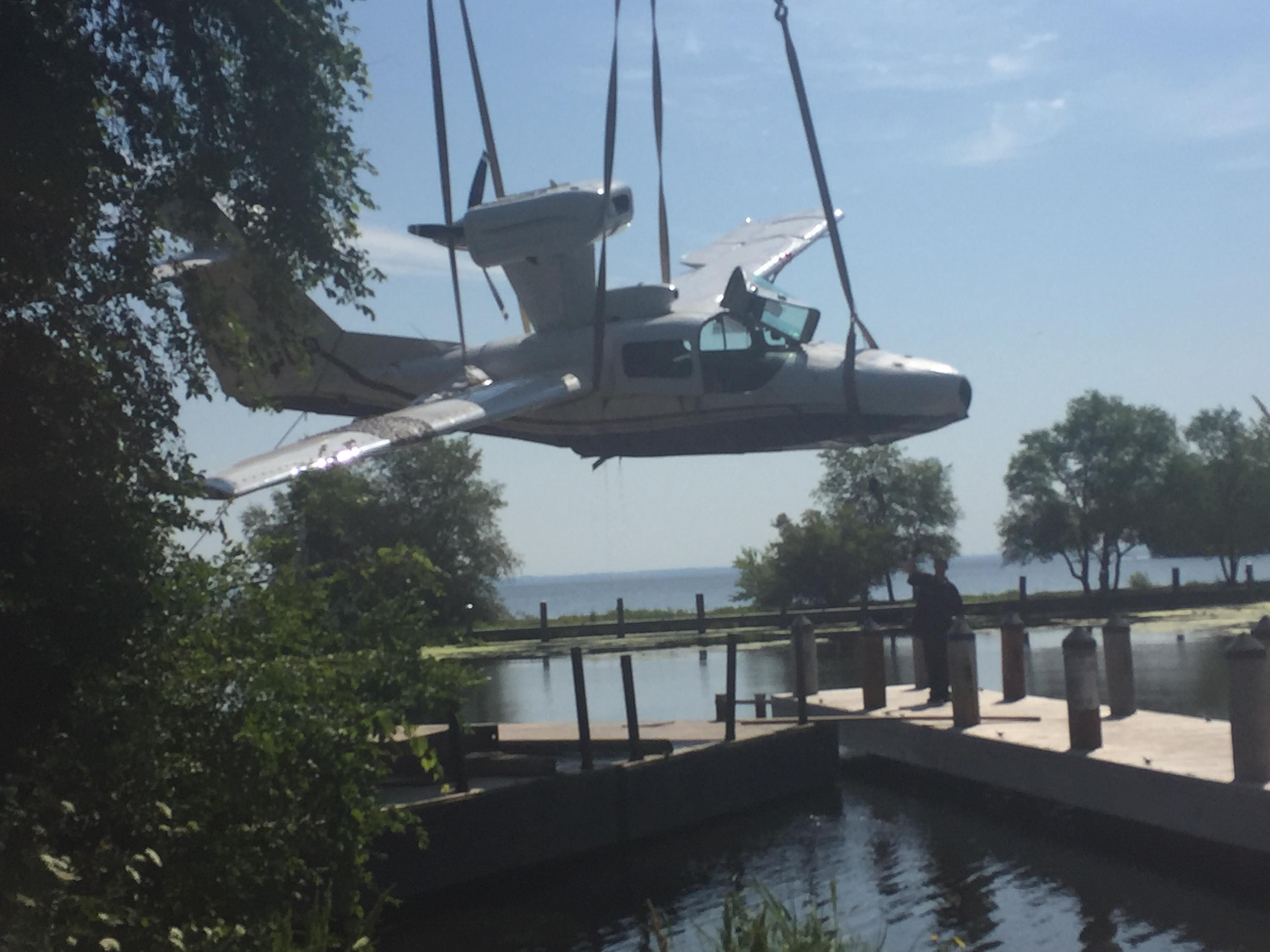 A seaplane is hoisted out of Lake Winnebago July 31, 2017, four days after it crashed into the lake. (WLUK/Brittay Ford)
