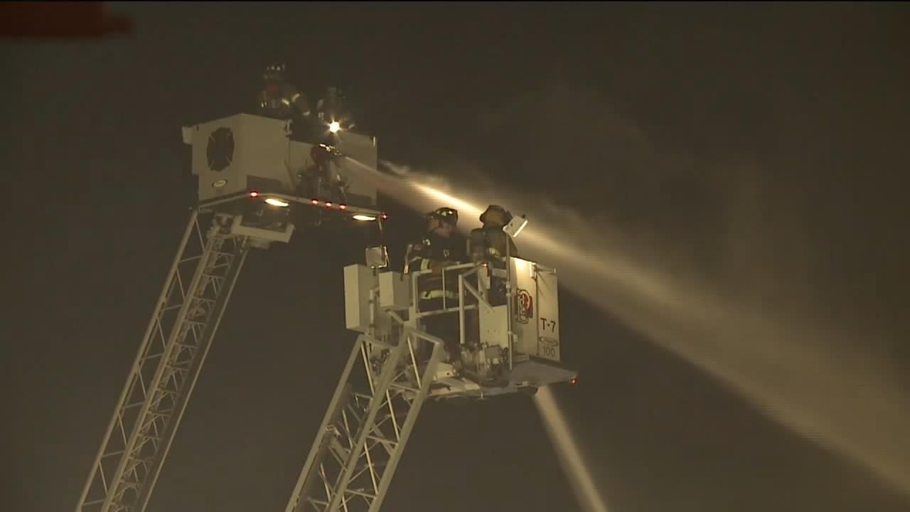 Firefighters battle a fire at an apartment in downtown Plymouth Nov. 9, 2017. (Image courtesy WITI-TV)<p></p>