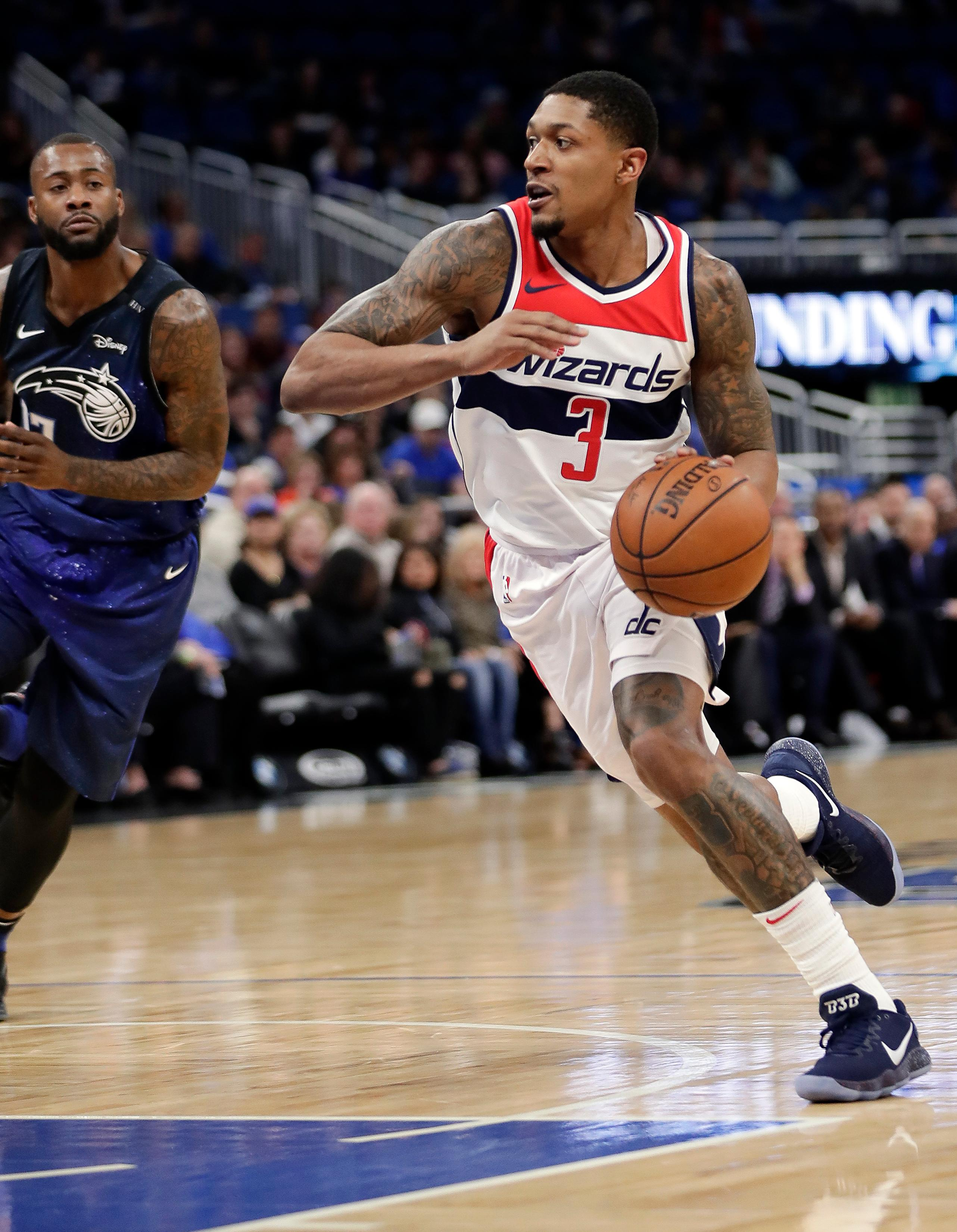 Washington Wizards' Bradley Beal (3) drives to the basket past Orlando Magic's Jonathon Simmons during the first half of an NBA basketball game Saturday, Feb. 3, 2018, in Orlando, Fla. (AP Photo/John Raoux)