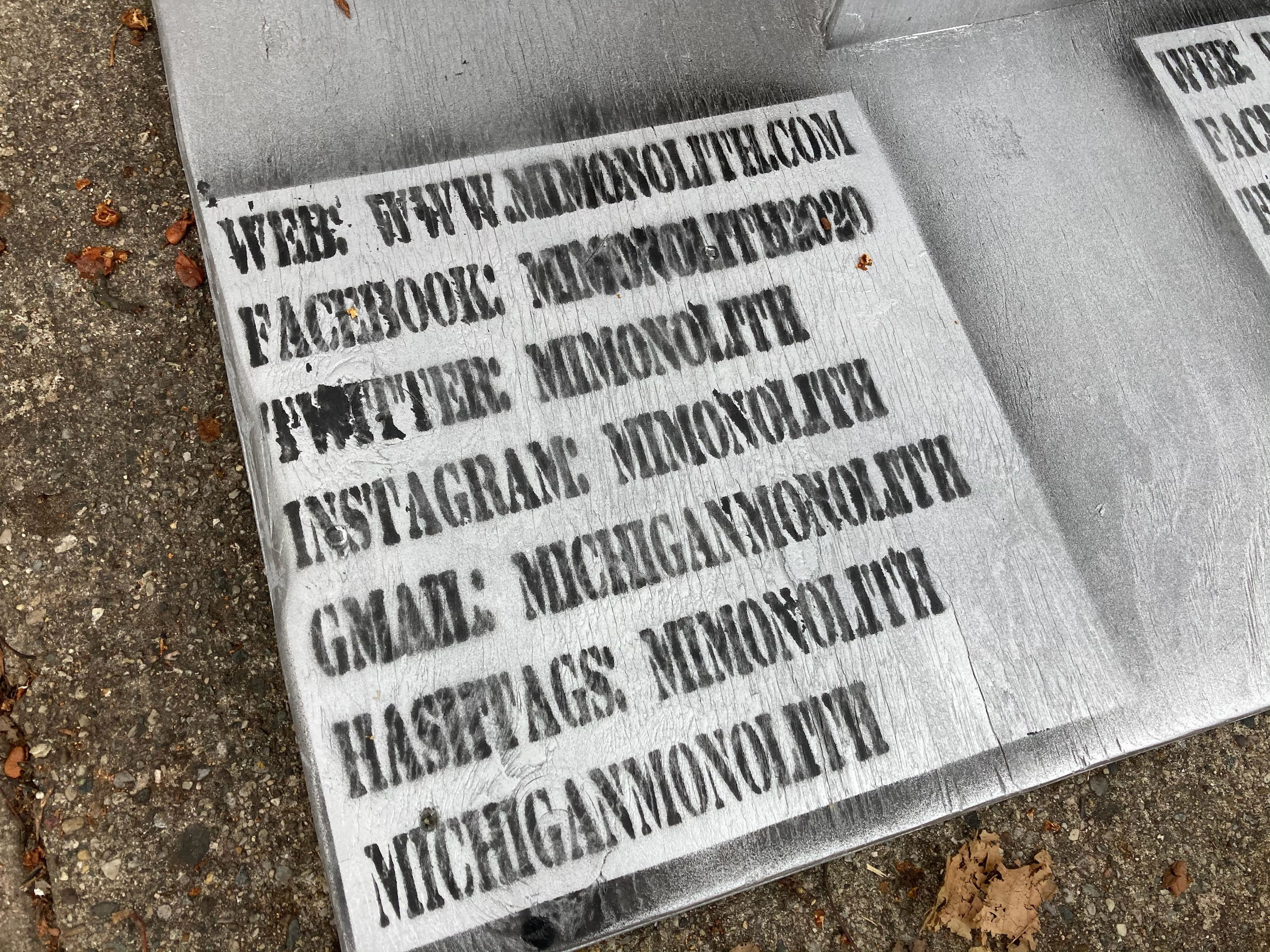 A monolith, mimicking others that have appeared in spots around the globe recently, appeared overnight in Lansing, Michigan, on Tuesday, Dec. 8, 2020, in the city's Old Town district. This one had a few placards on its base, with a listing of websites and social media accounts using the words Michigan monolith. (WWMT/ Rachel Louise Just)