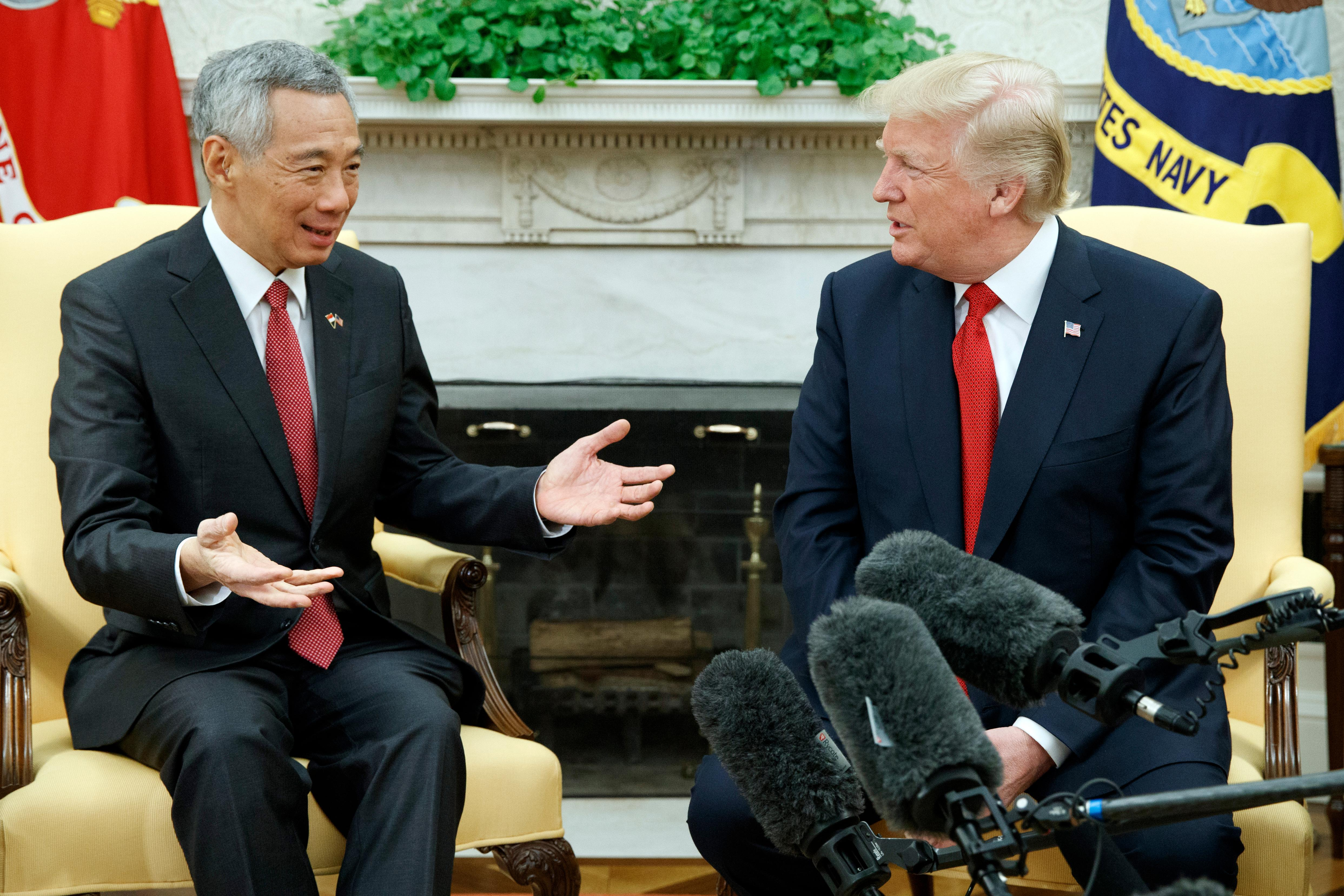 President Donald Trump listens as Singapore's Prime Minister Lee Hsien Loong speaks during a meeting in the Oval Office of the White House, Monday, Oct. 23, 2017, in Washington. (AP Photo/Evan Vucci)