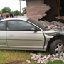 Driver crashes into parked car; pushes it into home