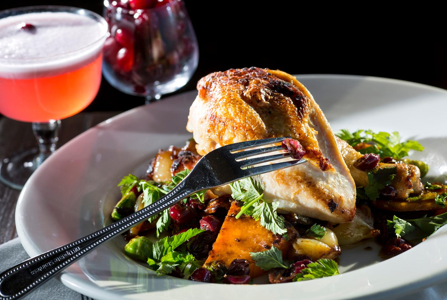 The half chicken, with butternut squash agrodolce, cranberry jus, brussels sprouts, cipollini onions, and sage, at Pickled Fish, located at 409 Sid Snyder Dr, Long Beach, WA. (Sy Bean / Seattle Refined)