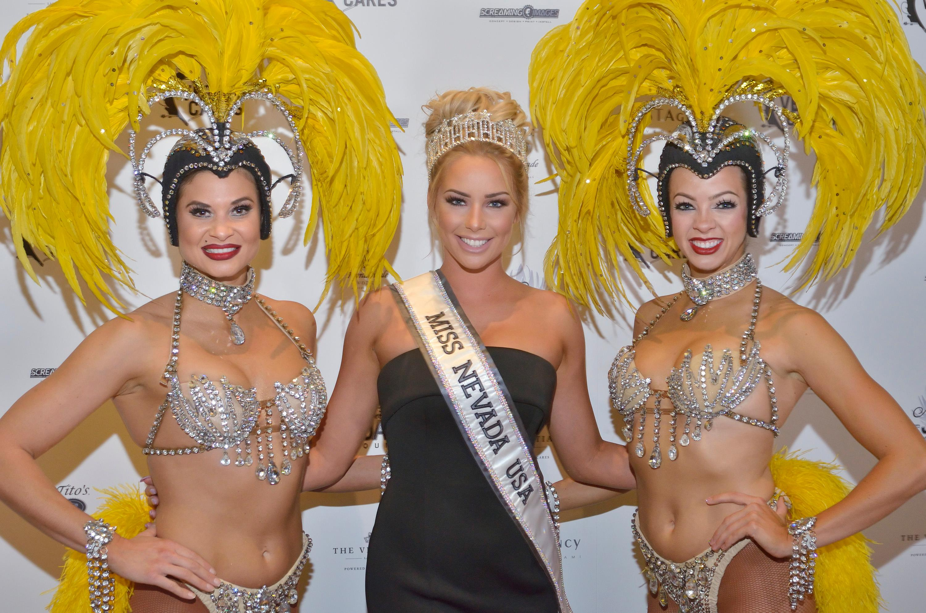 "Showgirls Dani Flahuie, left, and Stephanie Bell, right, are shown with Lauren York, Miss Nevada USA 2017, at the ""Vegas Cares"" benefit concert at the Venetian Theatre in the Venetian hotel-casino at 3355 S. Las Vegas Blvd in Las Vegas on Sunday, Nov 5, 2017. The concert was sponsored by a group of Las Vegas entertainers, producers and business professionals to honor the victims and first responders from shooting at the Route 91 Harvest festival. (Photo/Las Vegas News Bureau/Bill Hughes)"