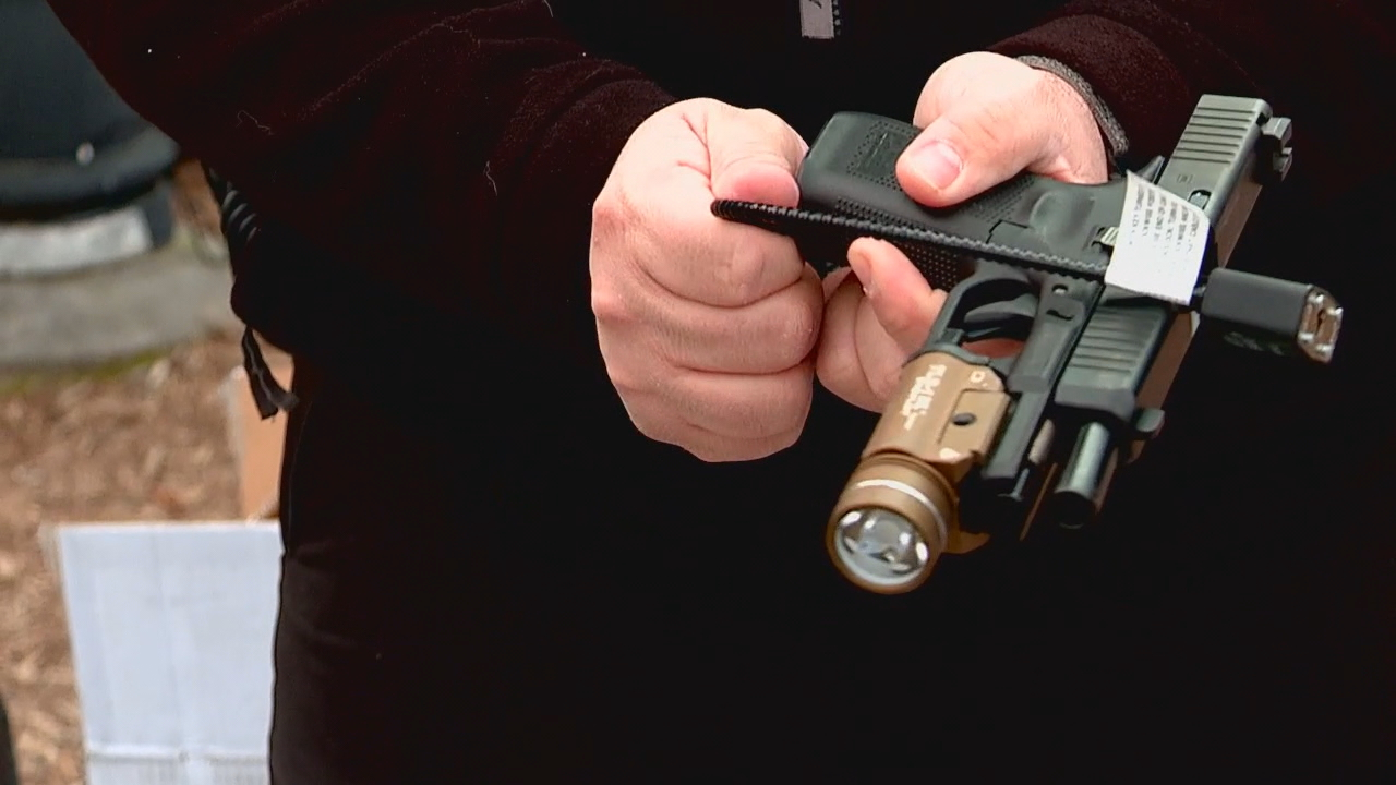 Hendersonville Police Department, with Project ChildSafe, held a firearm safety kit drive-thru Saturday, Jan. 16, where residents were encouraged to drive up, pick up a cable-style gun lock and talk to officers about safety. (Photo credit: WLOS Staff)