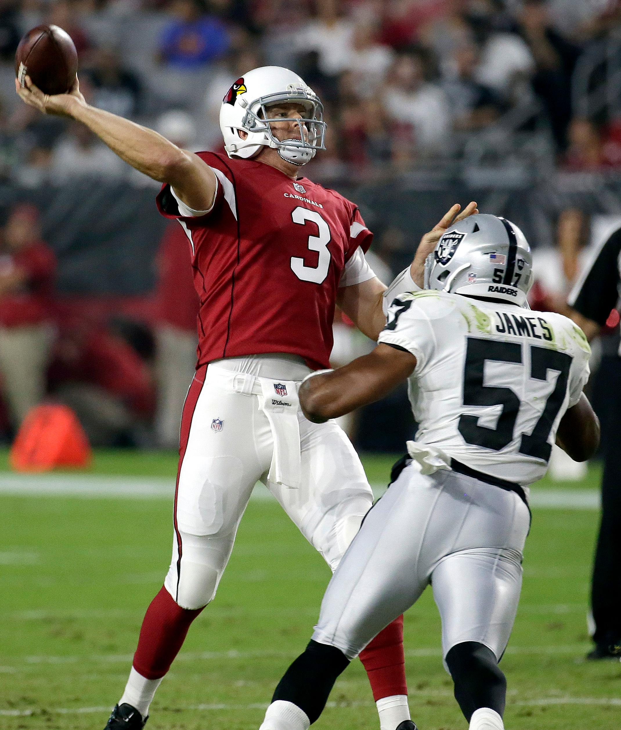 Arizona Cardinals quarterback Carson Palmer (3) throws under pressure from Oakland Raiders middle linebacker Cory James (57) during the first half of an NFL preseason football game, Saturday, Aug. 12, 2017, in Glendale, Ariz. (AP Photo/Rick Scuteri)