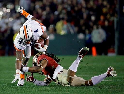 Florida State's Ronald Darby trips up Auburn's Quan Bray (4) after a catch during the second half of the NCAA BCS National Championship college football game Monday, Jan. 6, 2014, in Pasadena, Calif.