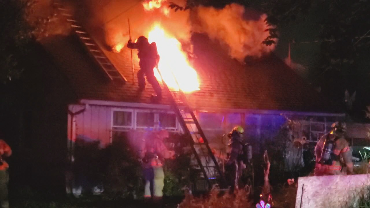 Crews responded to a house fire in Northeast Portland on Oct. 11, 2019. Three adults and pets made it out safely. KATU photo