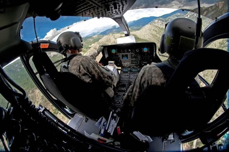 Chief Warrant Officers 4 Mike Eger and Troy Parmley fly a UH-72 Lakota helicopter over flooded areas as part of relief & recovery operations near Fort Collins, Colo., Sept. 18, 2013. Eager & Parmley are pilots with the Colorado Army National Guard.