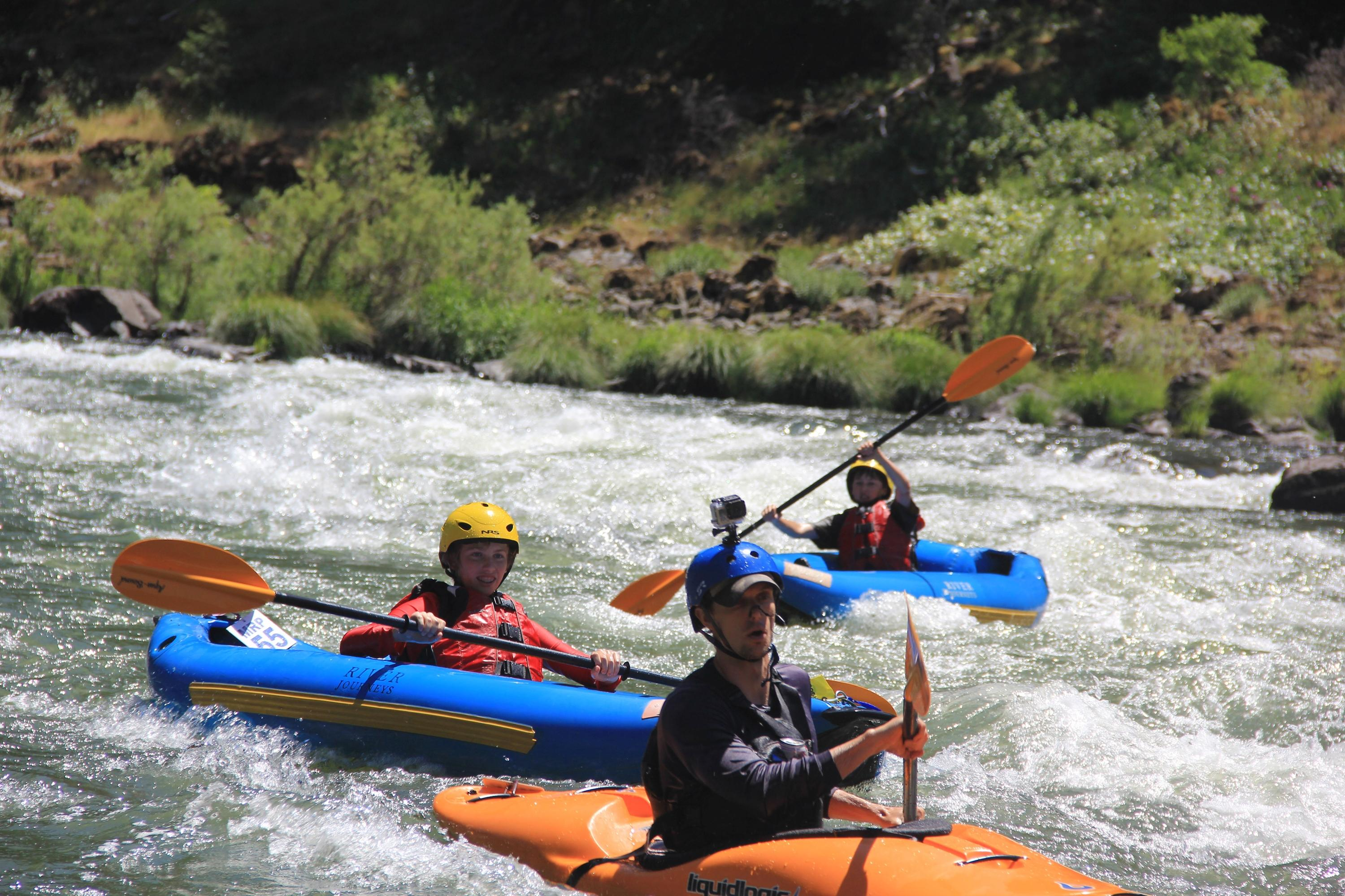 Zach Urness, along with Eli and Rylan take kayaks down the Rogue River. Photo by Robyn Orr
