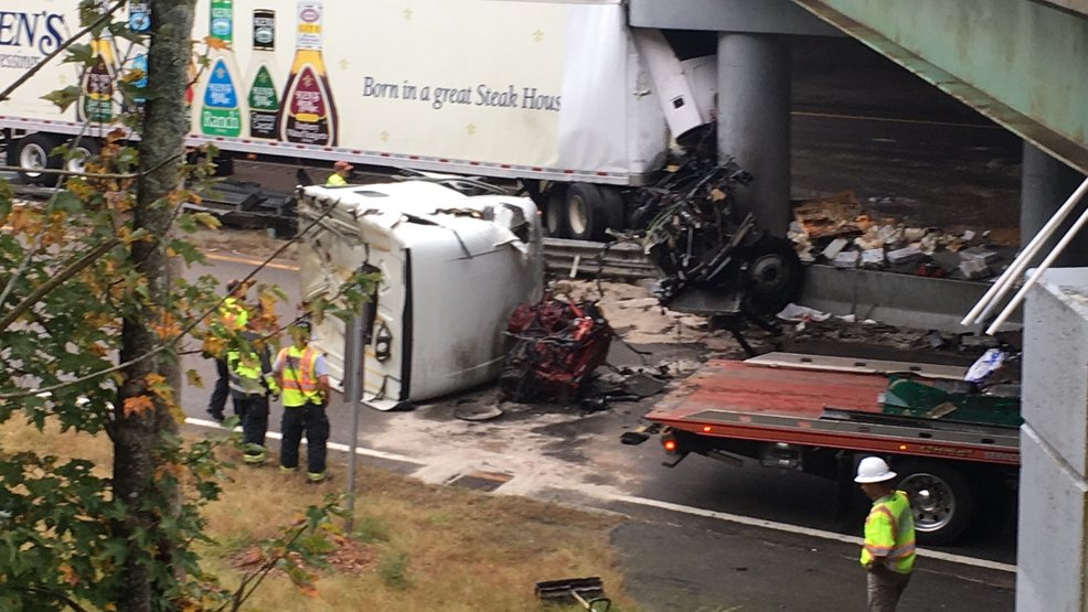 Tractor-trailer crashes into abutment on I-495 | WJAR