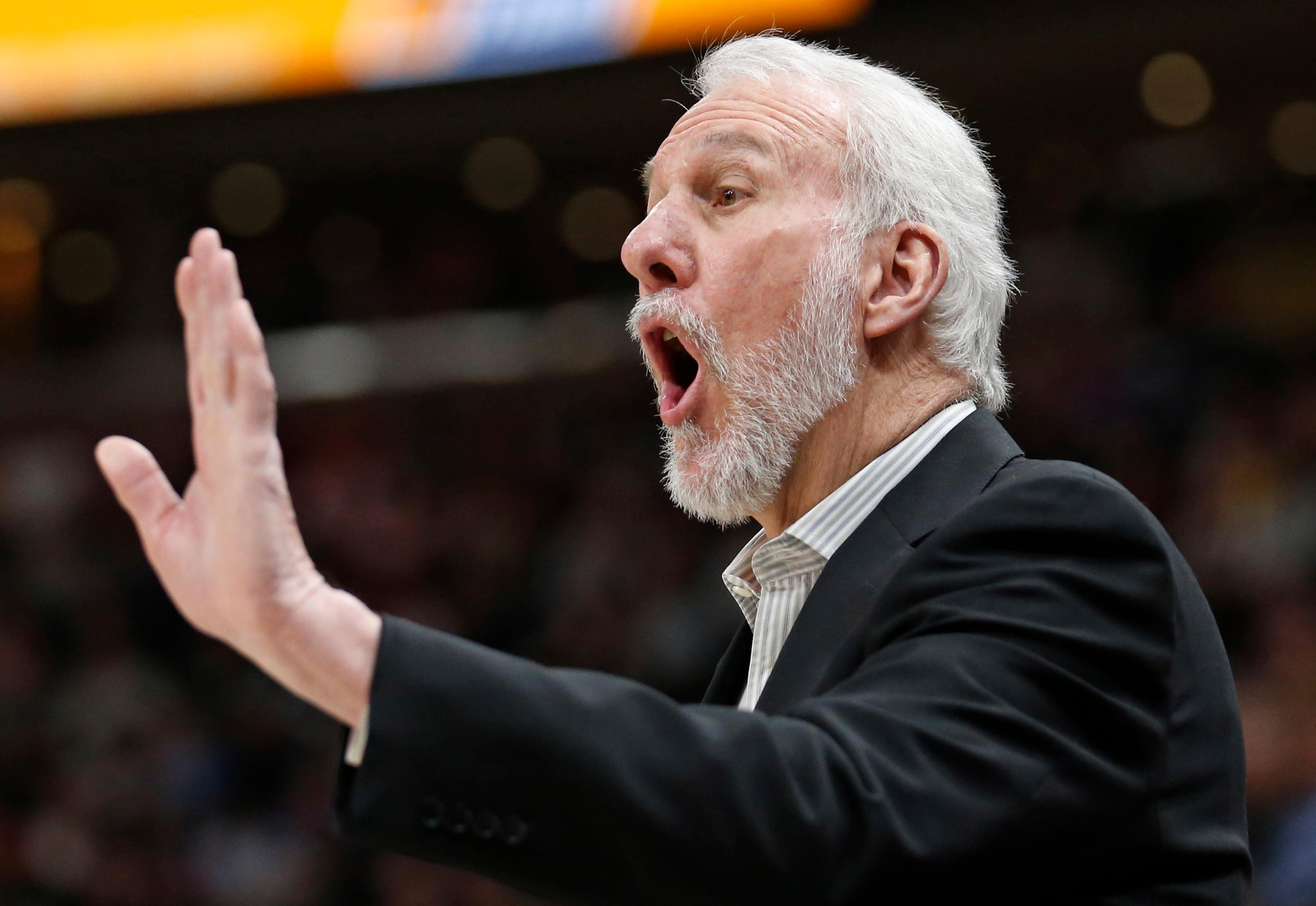 San Antonio Spurs head coach Gregg Popovich shouts to his team in the first half of an NBA basketball game against the Utah Jazz Monday, Feb. 12, 2018, in Salt Lake City. (AP Photo/Rick Bowmer)