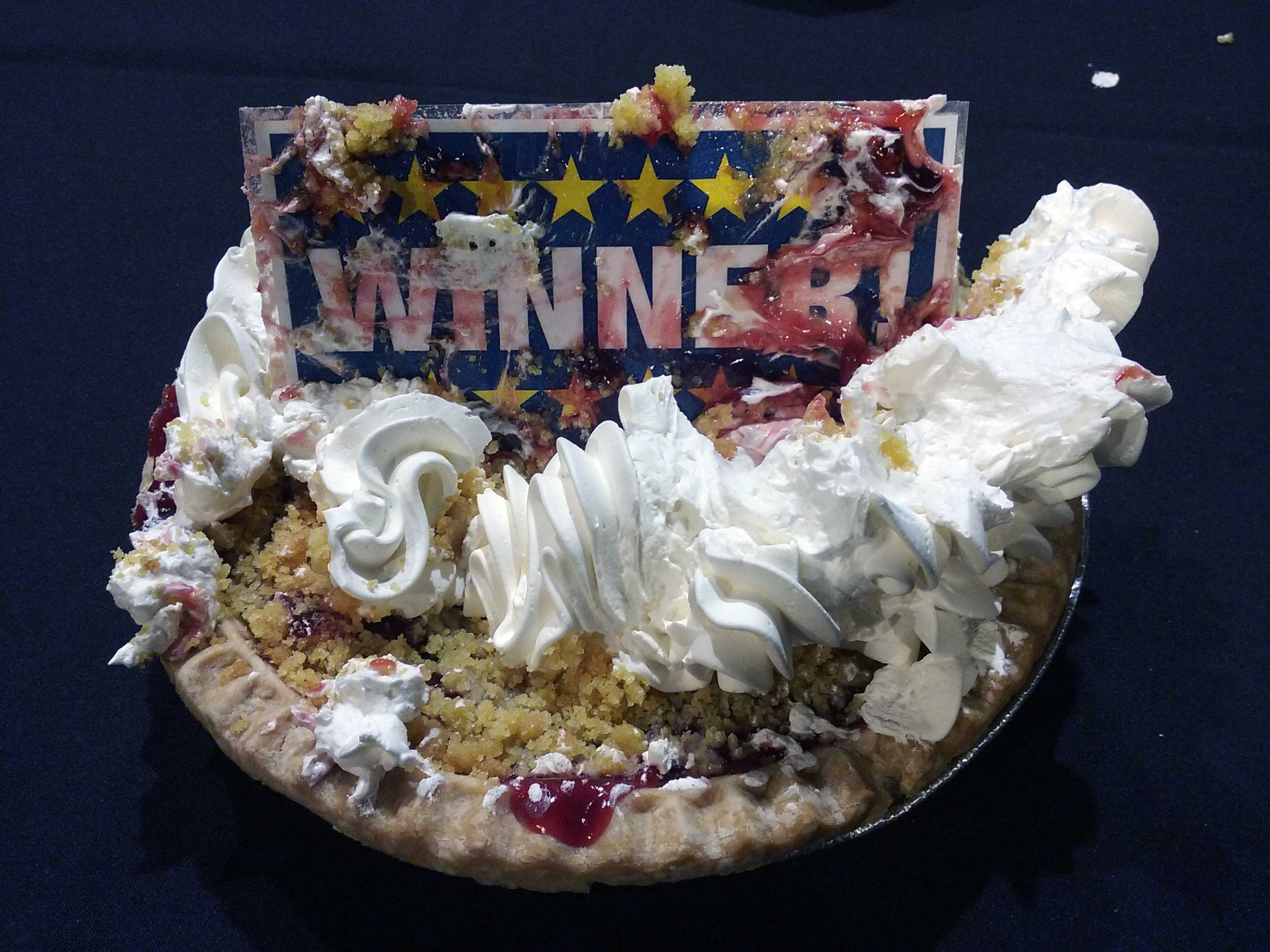 The Good Day Wisconsin Broadway Nights winning ticket sits atop a pie April 13, 2017, at the Fox Cities Performing Arts Center in Appleton. (WLUK/Kimberly Krejcarek)