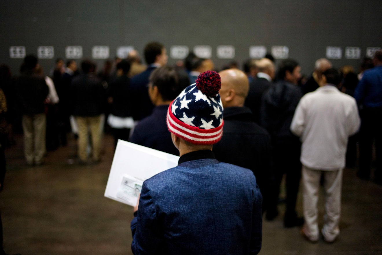 Vietnamese immigrant Tai Phu waits in line to pick up his U.S. citizenship certificate at a naturalization ceremony at the Los Angeles Convention Center, Wednesday, Feb. 15, 2017, in Los Angeles. About 3,000 people took the oath in the morning and more than 3,500 others were expected during an afternoon ceremony, according to U.S. Citizenship and Immigration Services officials.(AP Photo/Jae C. Hong)