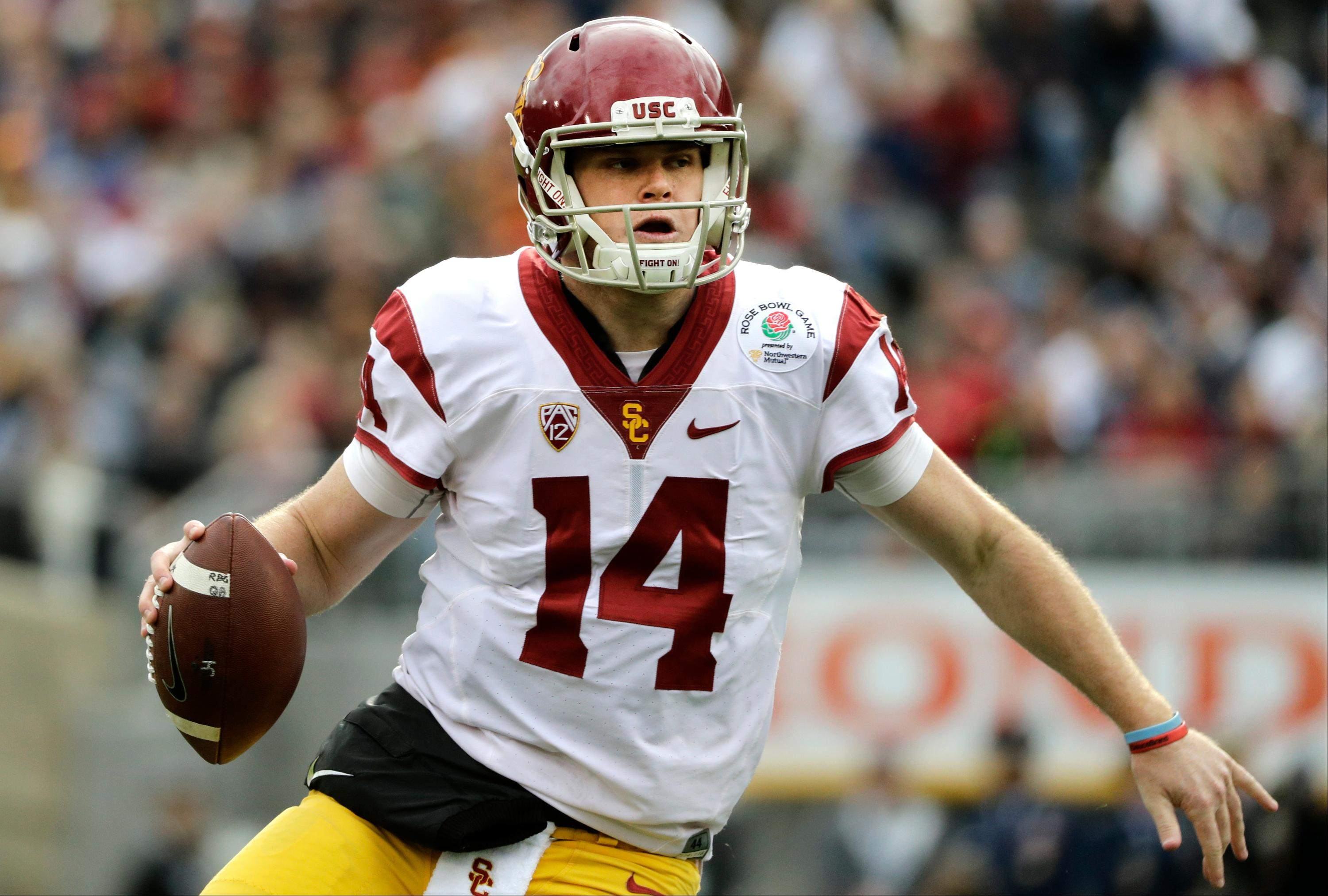 FILE - In this Jan. 2, 2017, file photo, Southern California quarterback Sam Darnold looks to pass against Penn State during the Rose Bowl NCAA college football game in Pasadena, Calif. Oregon running back Royce Freeman, USC quarterback Sam Darnold and UCLA quarterback Josh Rosen are among the Pac-12 players to keep an eye on coming out of spring practice. (AP Photo/Jae C. Hong, File)