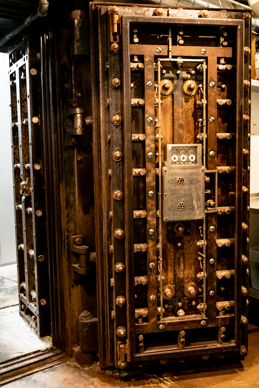 The bar features remnants of its past as a bank, such as this vault door. / Image: Amy Elisabeth Spasoff // Published: 1.24.19
