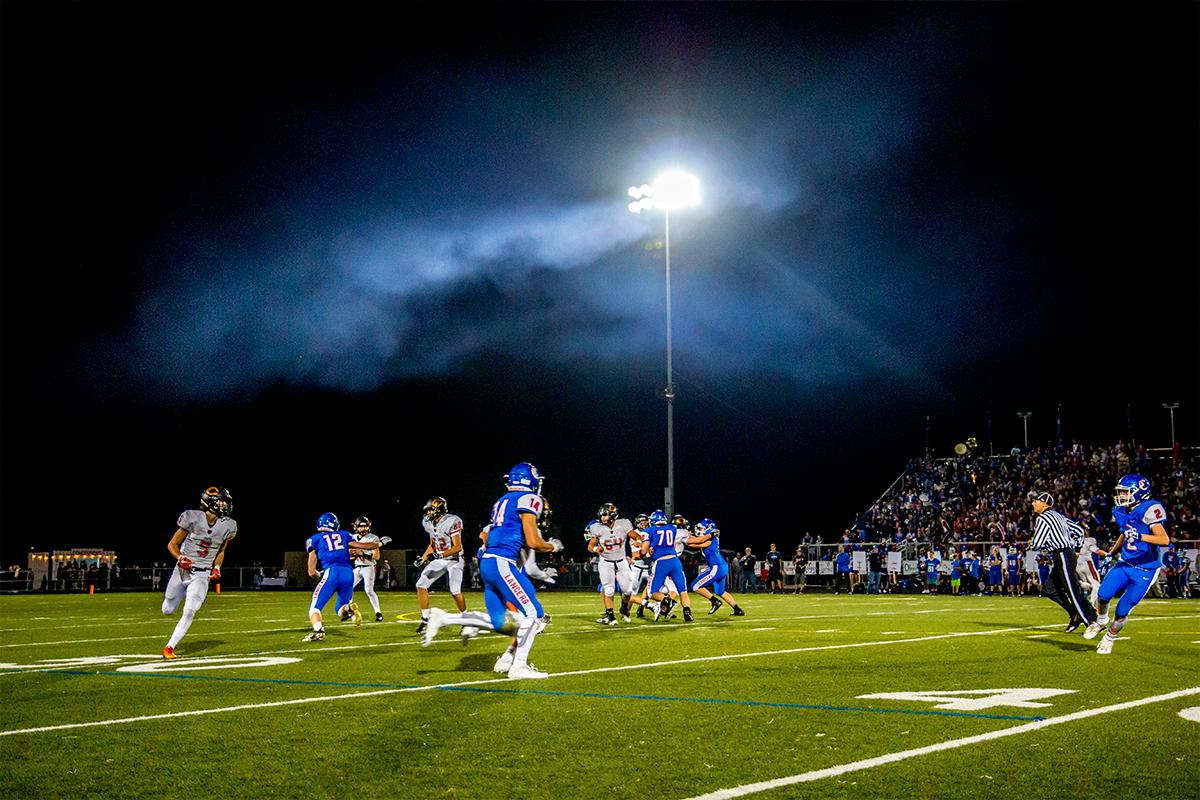 Smoke from the concessions stand hovers above the crowd. Churchill defeated Crater 63-21 on Friday at their homecoming game. Churchill remains undefeated with a conference record of 9-0. Photo by Rhianna Gelhart, Oregon News Lab