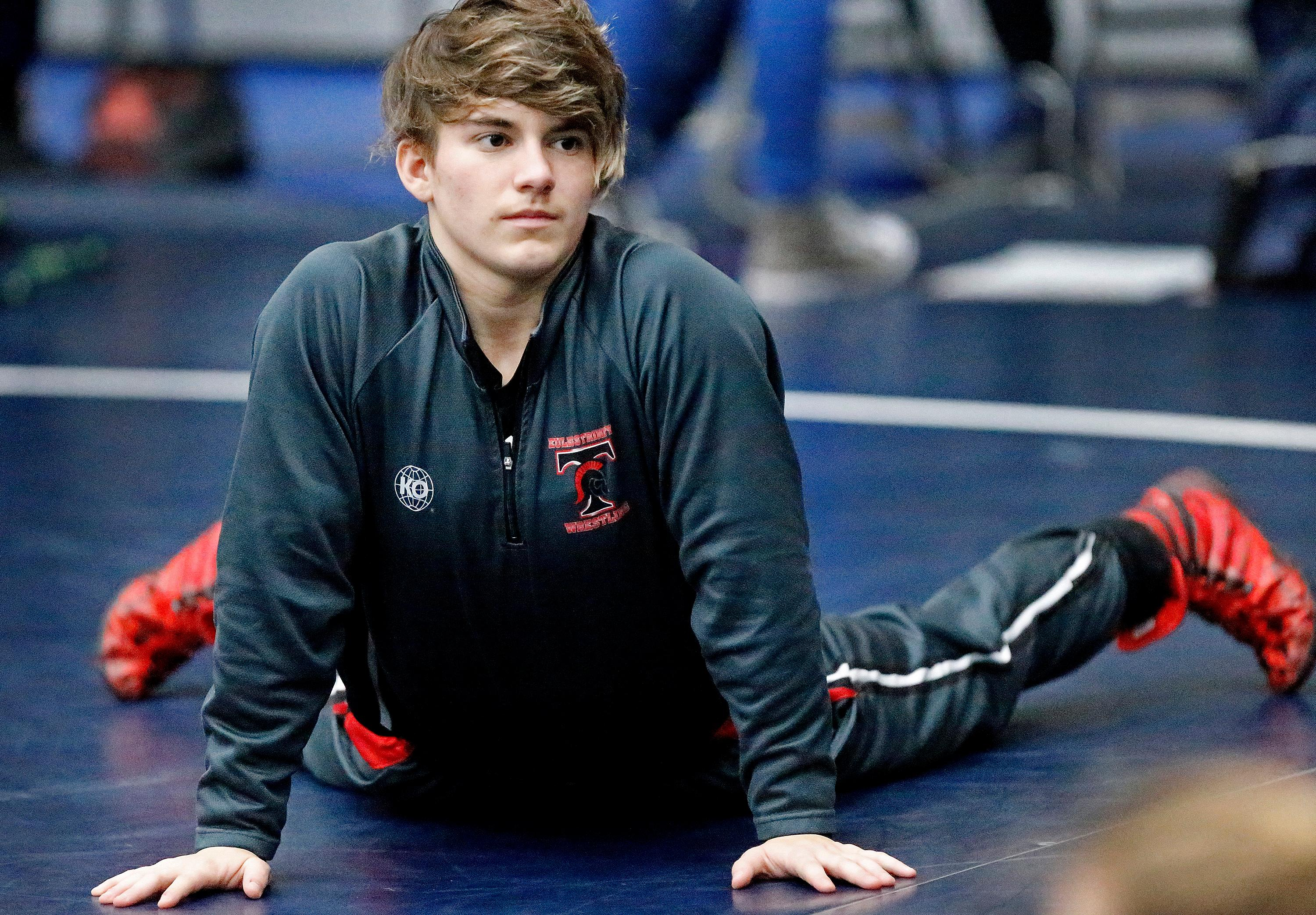 In this Saturday, Feb. 17, 2018 photo, Trinity High School wrestler Mack Beggs warms up before her match at the 6A Region II wrestling meet held at Allen High School in Allen, Texas . Beggs, a senior from Euless Trinity High School near Dallas is transgender and in the process of transitioning from female to male. (Stewart F. House/The Dallas Morning News via AP)