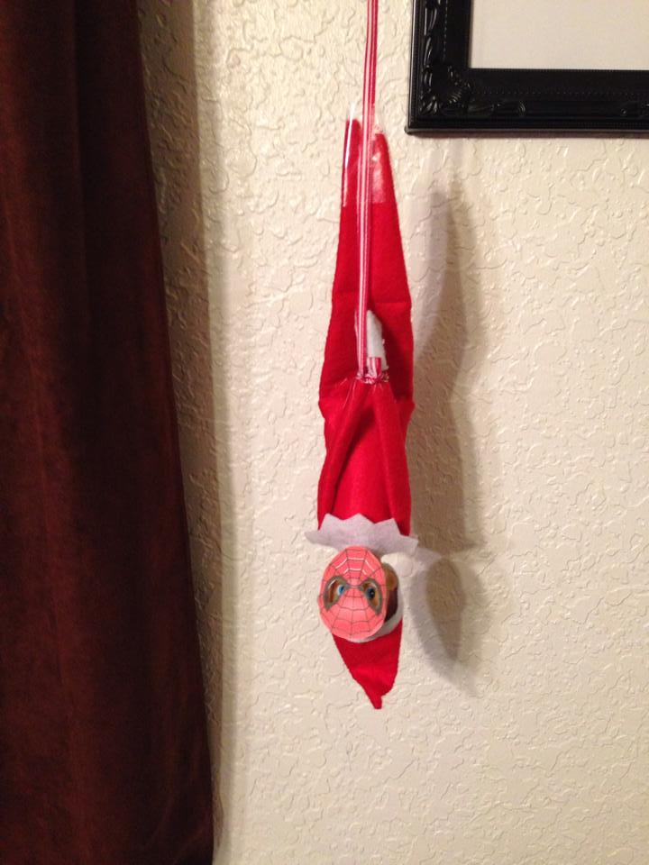 Audrie Fuller Brese's Elf isn't sitting on the Shelf, he's hanging from it as Spiderman.