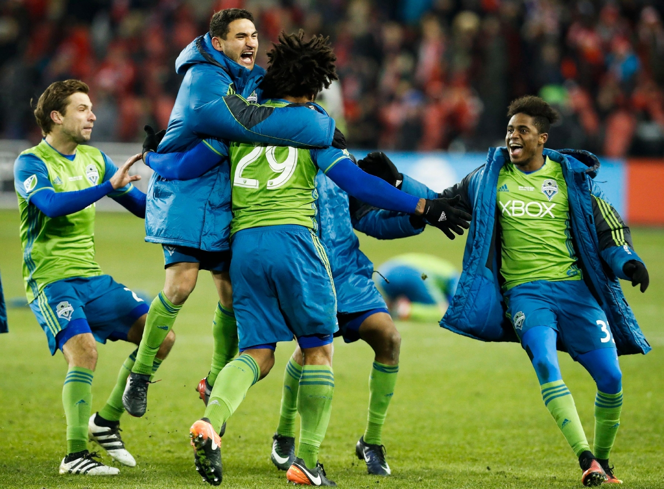Seattle Sounders teammates congratulate Roman Torres (29) after he scored the winning penalty kick to defeat Toronto FC during a shootout at the MLS Cup soccer final in Toronto, Saturday, Dec. 10, 2016. (Mark Blinch/The Canadian Press via AP)