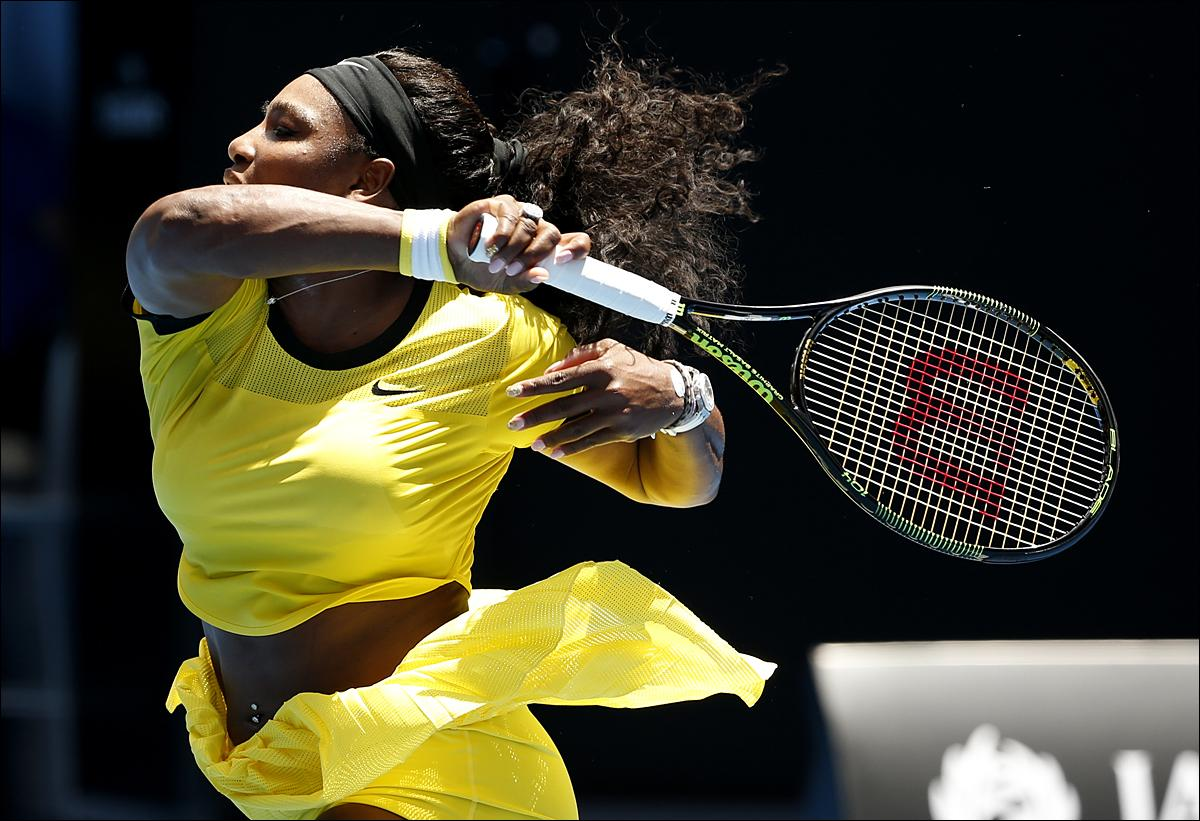 Serena Williams of the United States follows through on a shot to Camila Giorgi of Italy during their first round match at the Australian Open tennis championships in Melbourne, Australia, Monday, Jan. 18, 2016.(AP Photo/Vincent Thian)
