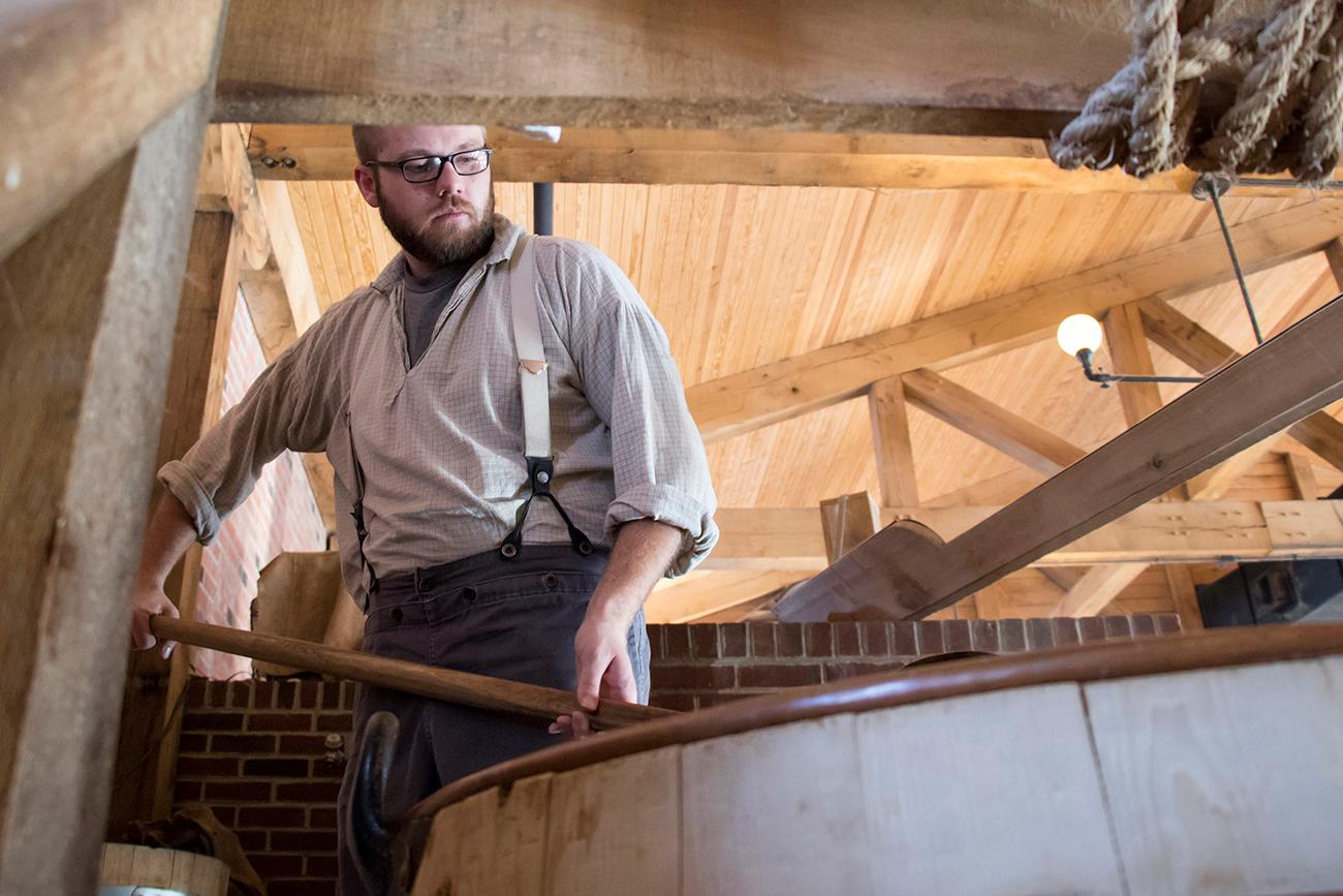 Each step of the brewing process is replicated from the 1850s, down to hand ladling water in the copper pots. / Image: Allison McAdams // Published: 1.16.18<p></p>